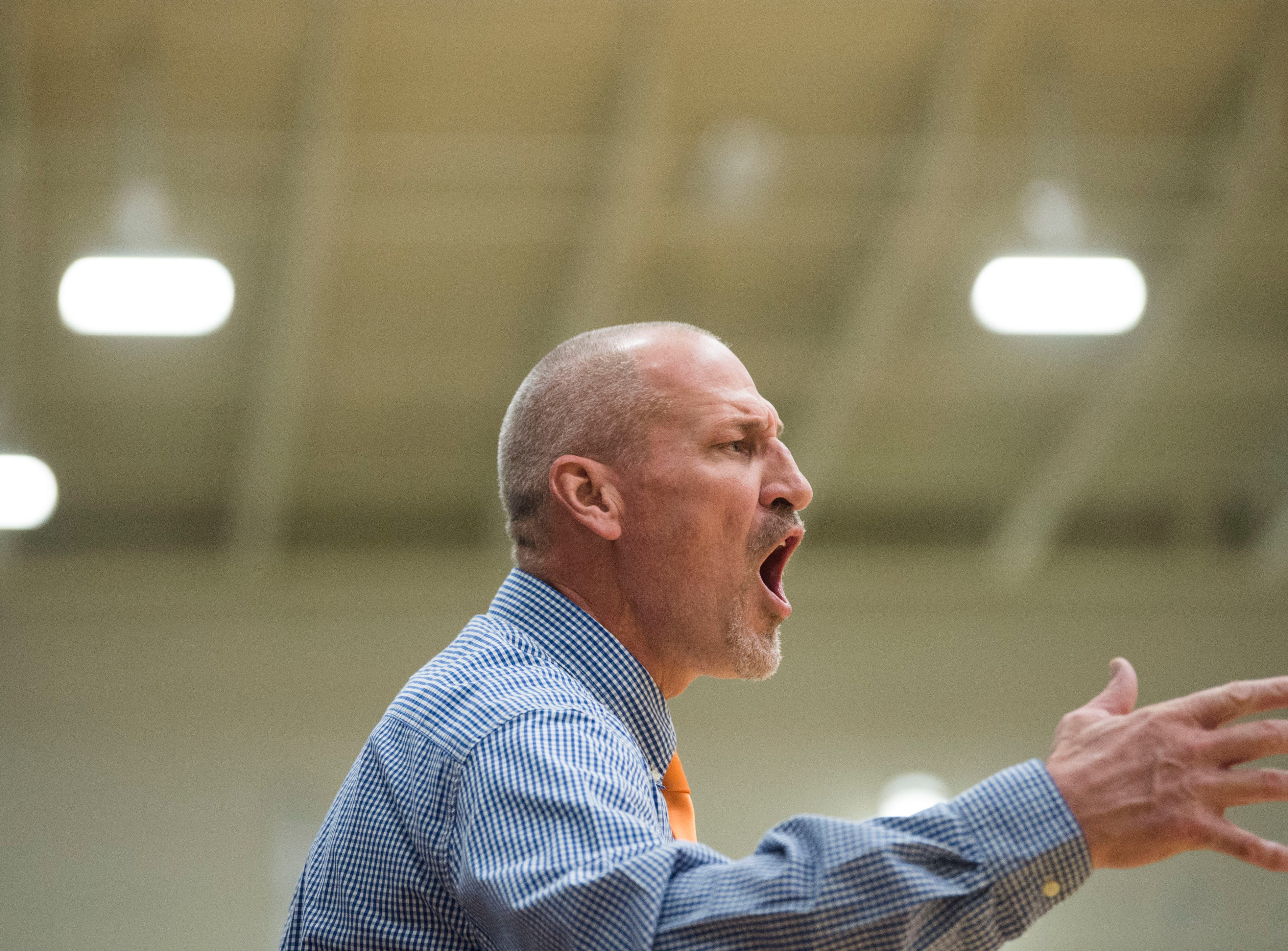 Campbell County's head coach Darrell Cox yells to the court during a high school basketball game between Oak Ridge and Campbell County at Oak Ridge Friday, Feb. 1, 2019.