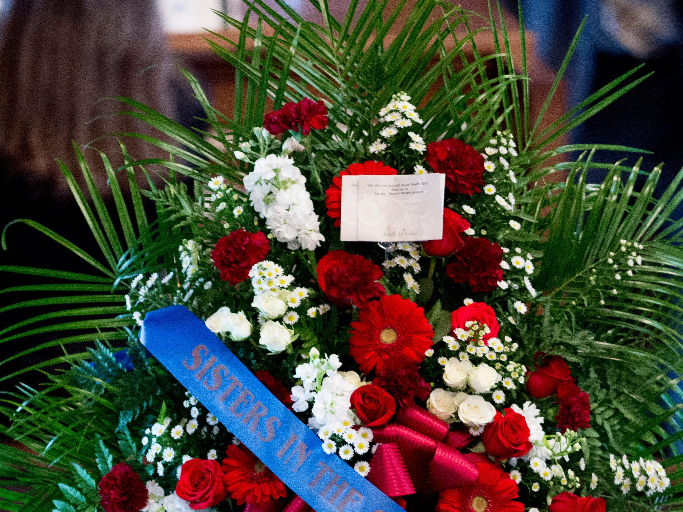 A wreath is displayed during a funeral service for Rosemary Mariner, the US Navy's first female fighter pilot, at Norris United Methodist Church in Norris, Tennessee on Saturday, February 2, 2019. Mariner died January 24th of cancer.