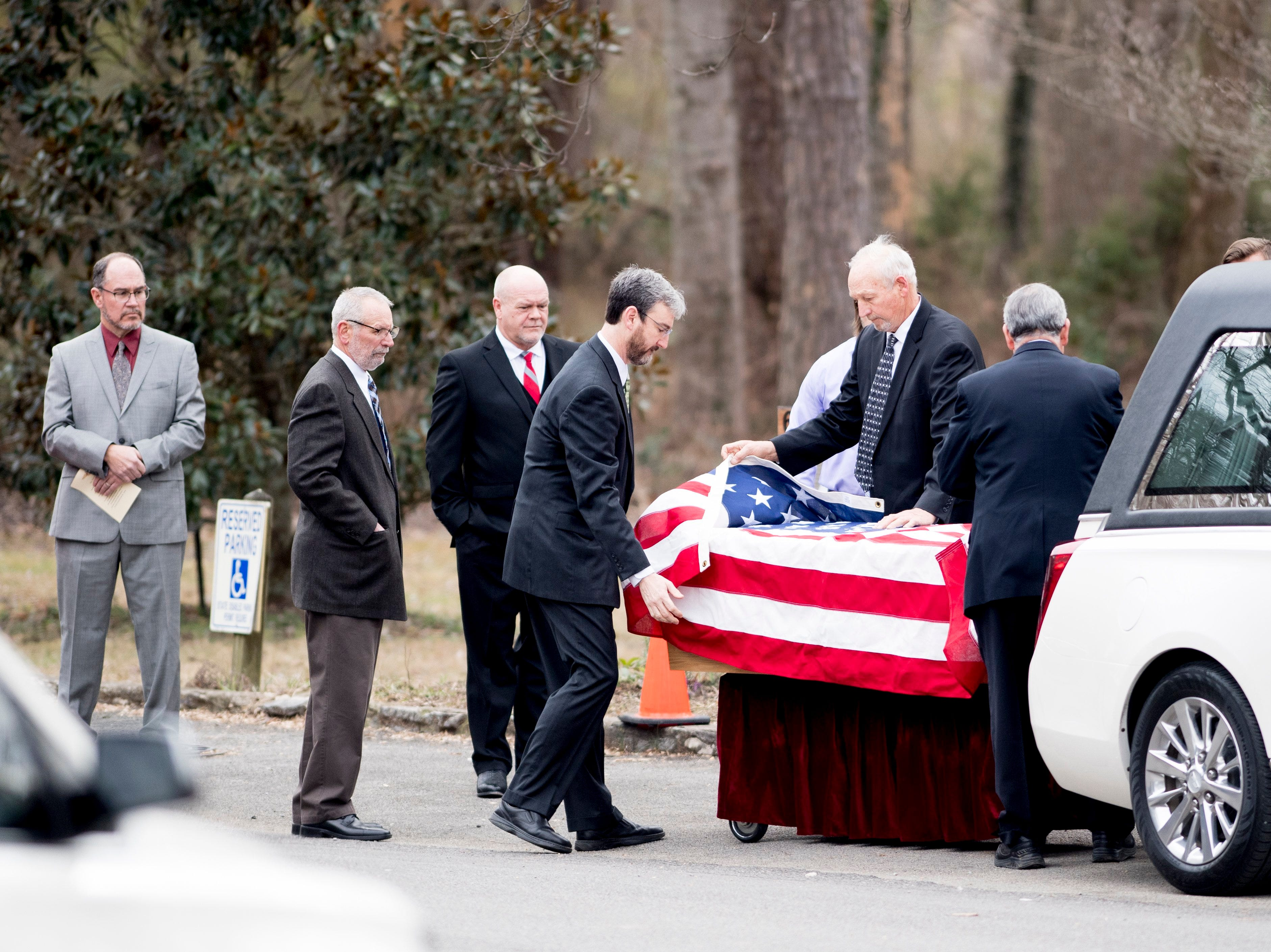 Pallbearers drape a United States flag over the casket of Rosemary Mariner, the US Navy's first female fighter pilot, at Norris United Methodist Church in Norris, Tennessee on Saturday, February 2, 2019. Mariner died January 24th of cancer.