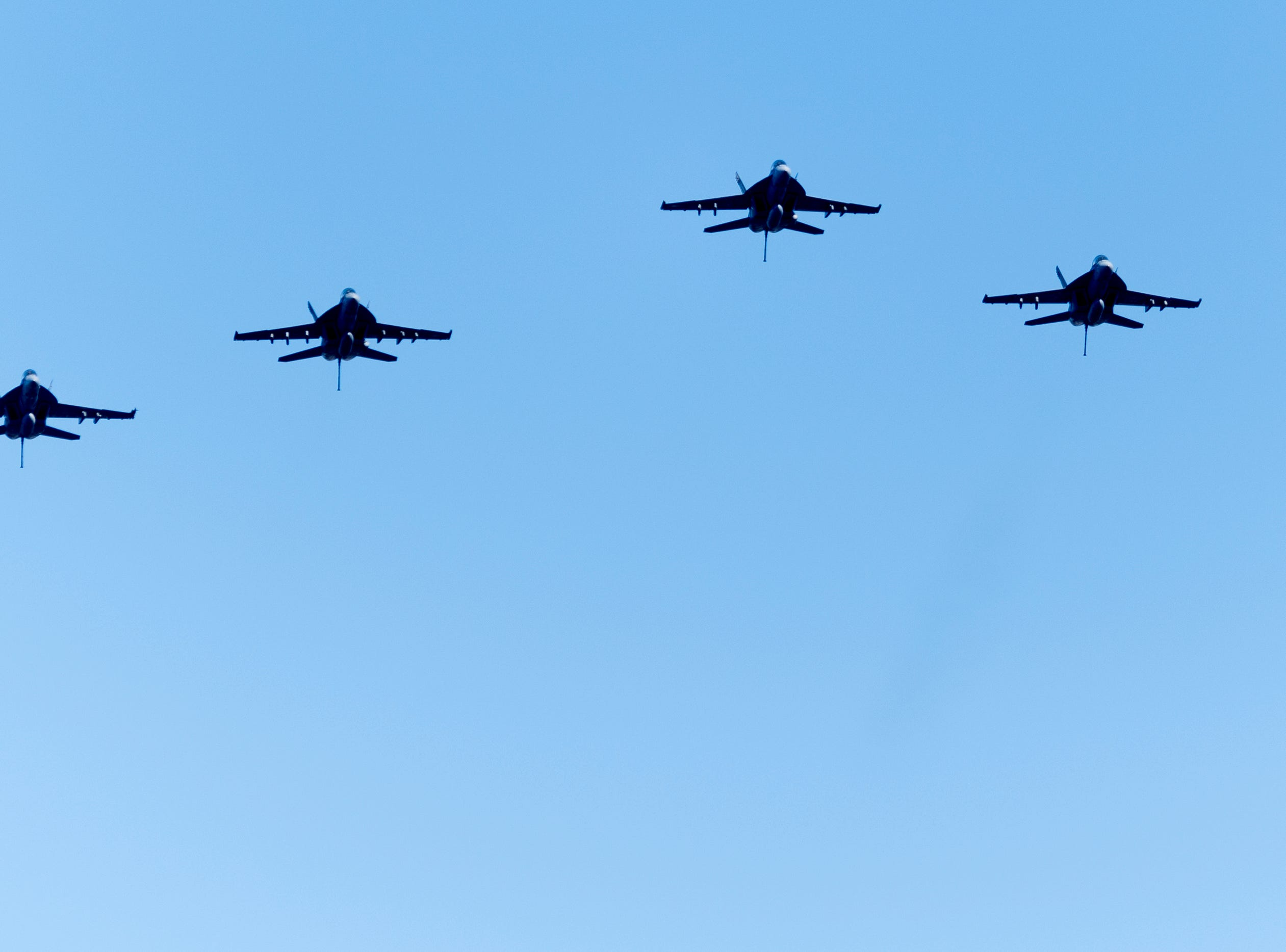 Four fighter jets fly above a graveside service for Rosemary Mariner, the US Navy's first female fighter pilot, at New Loyston Cemetery in Maynardville, Tennessee on Saturday, February 2, 2019. The jets were flown by four female fighter pilots, and was the first all-female flyover by the Navy.