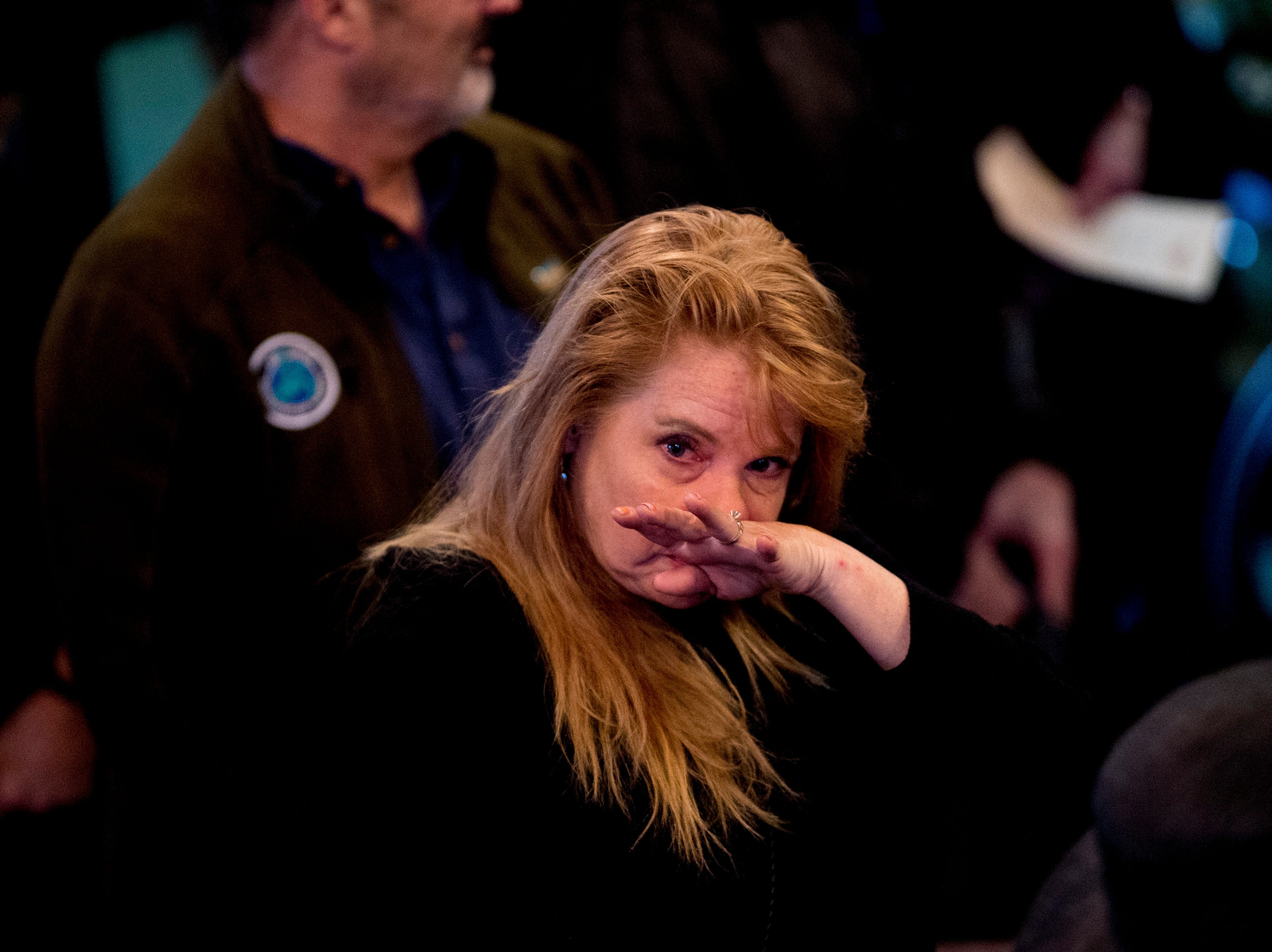 An attendee wipes away tears during a funeral service for Rosemary Mariner, the US Navy's first female fighter pilot, at Norris United Methodist Church in Norris, Tennessee on Saturday, February 2, 2019. Mariner died January 24th of cancer.