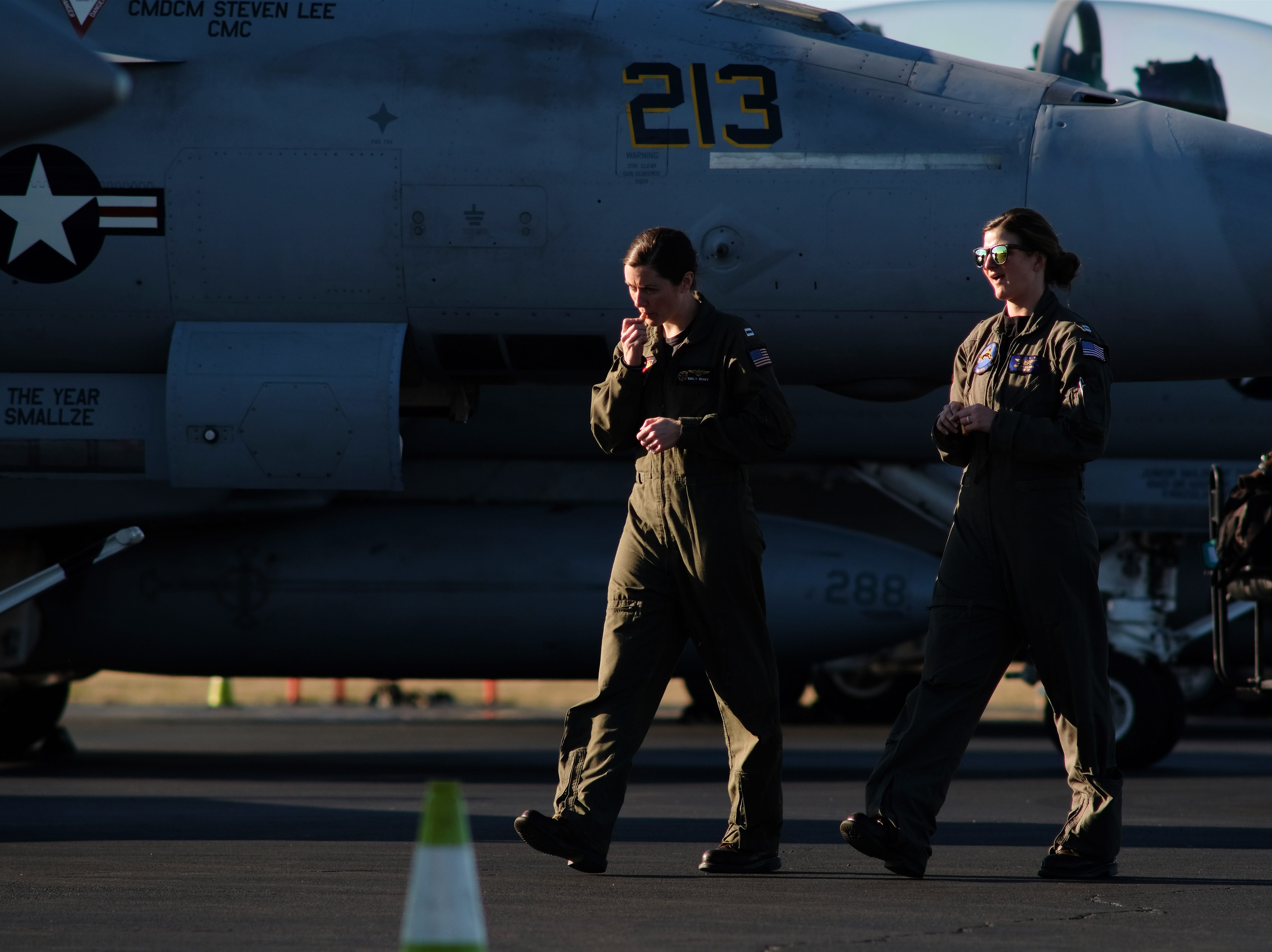 "Navy pilots, from left, LT Kelly ""Ston'er"" Harris and LCDR Jennifer ""Cujo"" Hesling returns from a flyover at the funeral of Rosemary Mariner, the Navy's first female fighter pilot, on Saturday, Feb. 2, 2019 at Knoxville's McGhee Tyson Airport."
