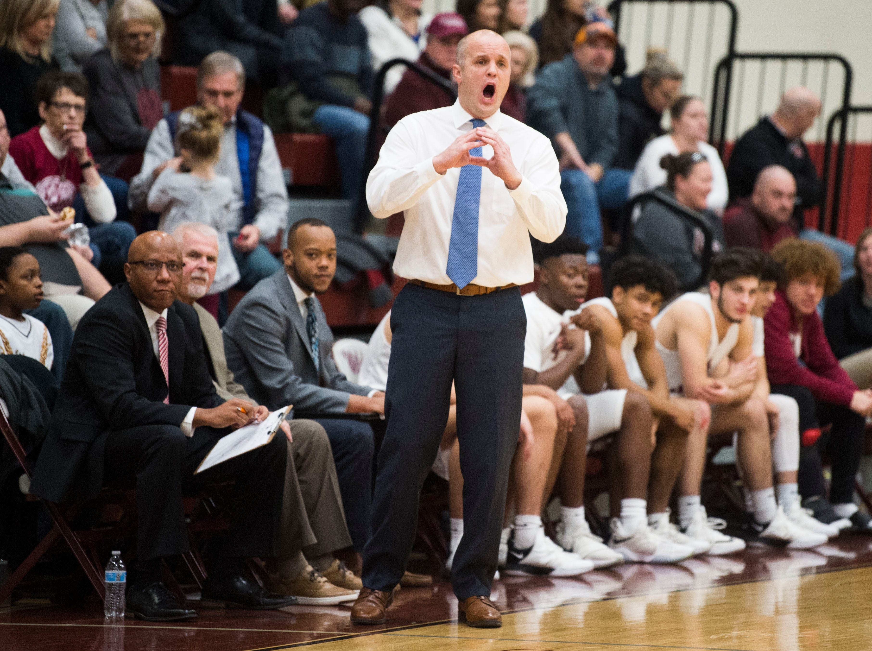 Oak Ridge coach Aaron Green yells to the court during a high school basketball game between Oak Ridge and Campbell County at Oak Ridge Friday, Feb. 1, 2019.