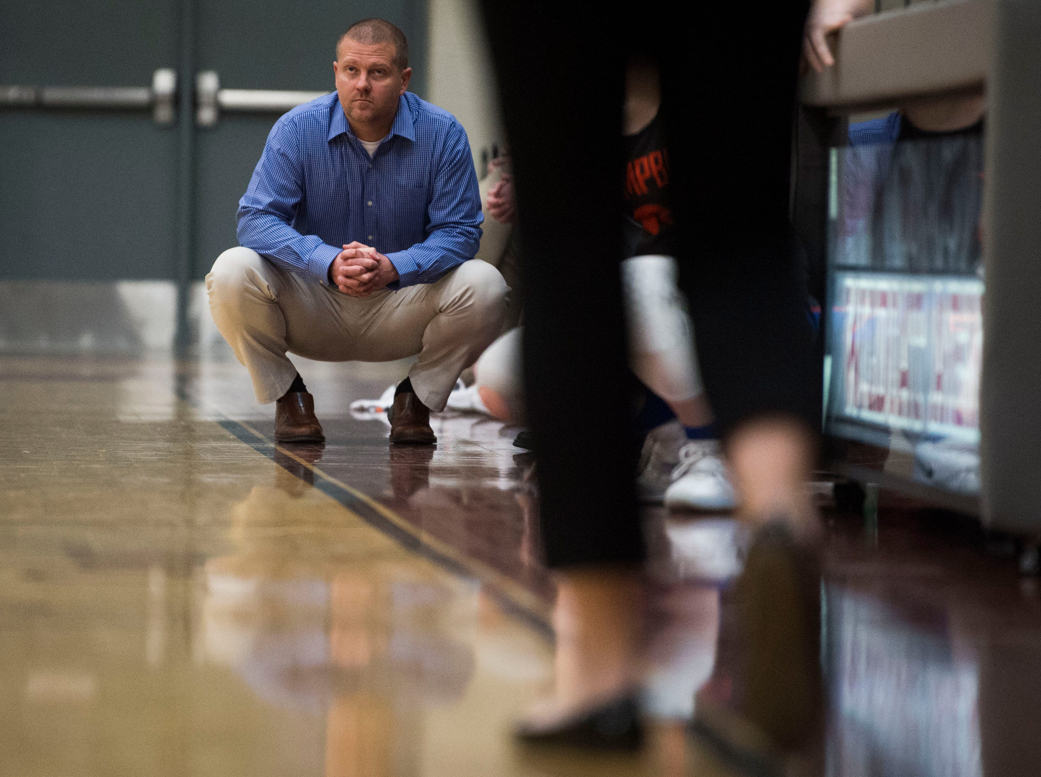 Campbell County's coach squats on the sidelines during a high school basketball game between Oak Ridge and Campbell County at Oak Ridge Friday, Feb. 1, 2019.
