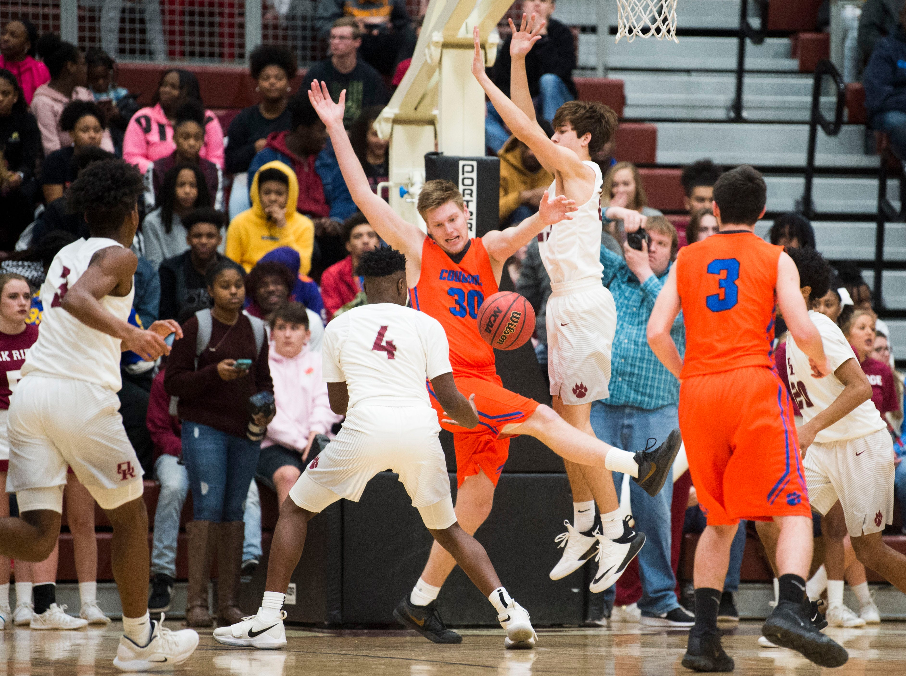 Players fight for the ball during a high school basketball game between Oak Ridge and Campbell County at Oak Ridge Friday, Feb. 1, 2019.