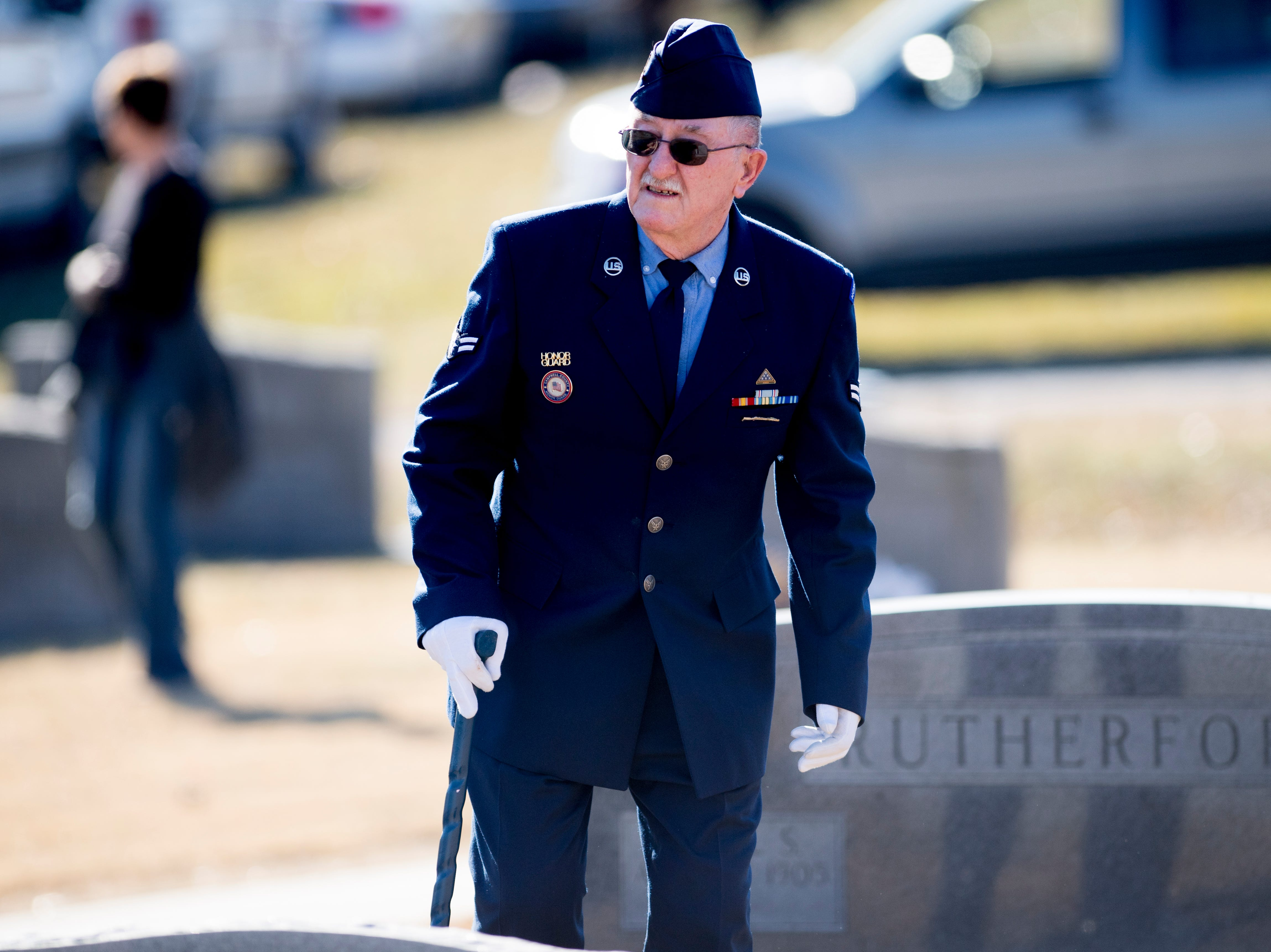 A member of the Campbell County Tennessee Honor Guard walks through the cemetery before a graveside service for Rosemary Mariner, the US Navy's first female fighter pilot, at New Loyston Cemetery in Maynardville, Tennessee on Saturday, February 2, 2019. Mariner died January 24th of cancer.