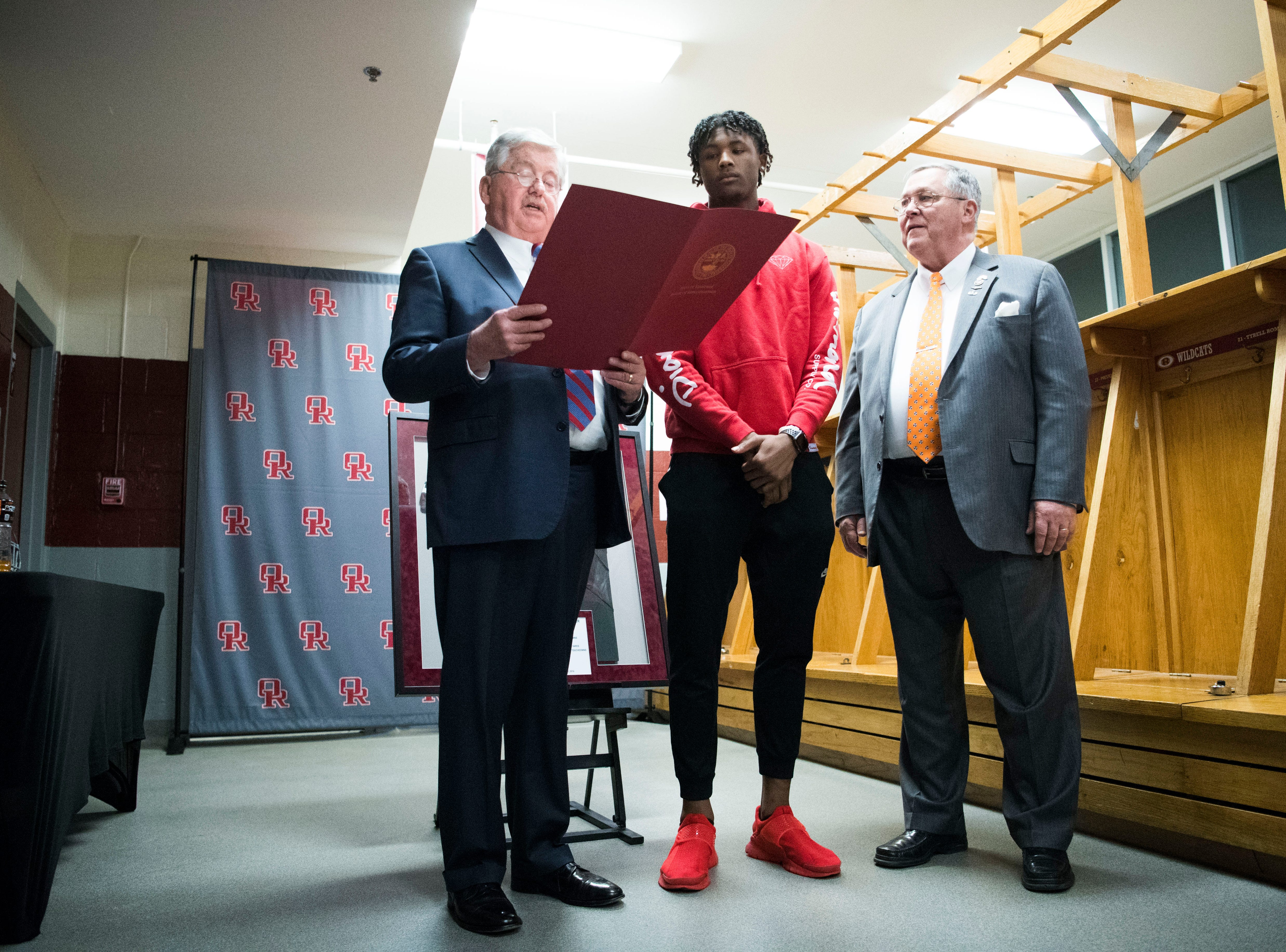 A proclamation is read for former Oak Ridge High School athlete Tee Higgins, now a wide receiver at Clemson University, after his jersey is retired, during a high school basketball game between Oak Ridge and Campbell County at Oak Ridge Friday, Feb. 1, 2019.