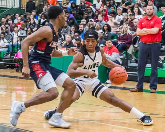 The Lafayette High boys basketball team plays the Comeaux High Spartans on Friday night Feb. 1, 2019.