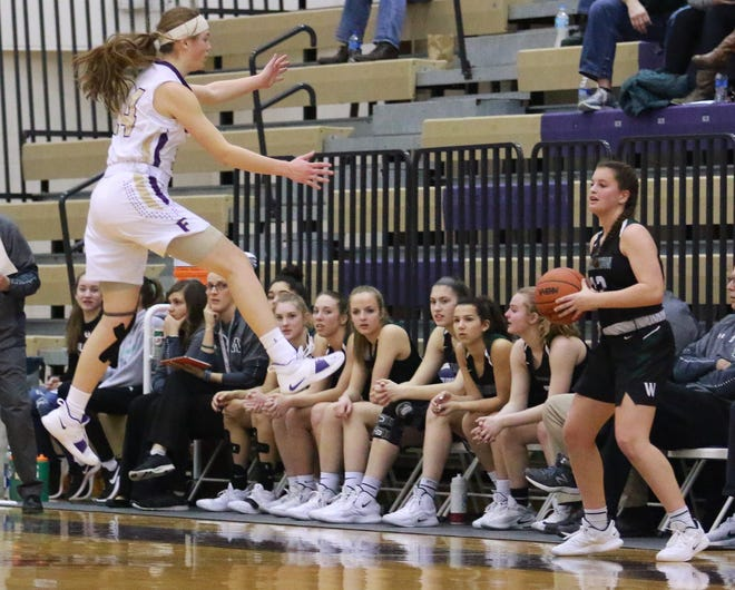 Elie Smith takes flight to contest an inbounds pass by Williamston's Kaley Douglass on Friday, Feb. 1, 2019.