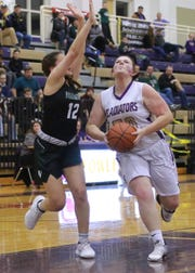 Fowlerville's Peyton Boden (50) drives through the lane while defended by Williamston's Kaley Douglass (12) on Friday, Feb. 1, 2019.