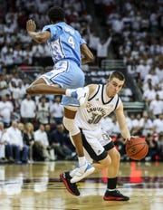 Louisville's Ryan McMahon gets knocked by North Carolina's Brandon Robinson but no foul was called in the first half as the Tarheels built their early lead. 'We got bullied,' said Card player Christen Cunningham. 'We got punked.' Louisville got beat by North Carolina 79-69. Feb. 2, 2019