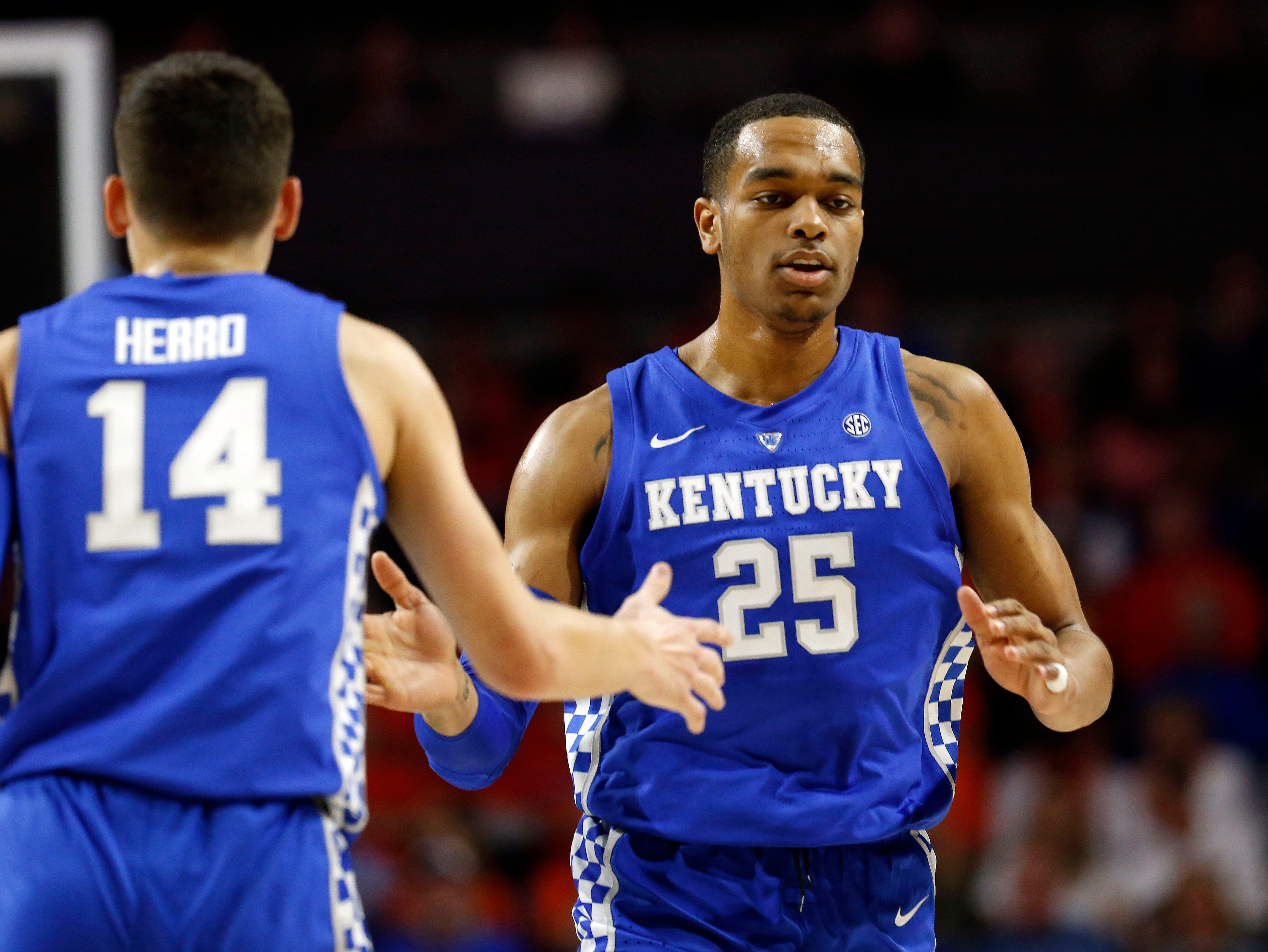 Kentucky Wildcats forward PJ Washington (25) and guard Tyler Herro (14) high five against the Florida Gators during the first half at Exactech Arena in Gainesville, Florida, on Saturday, Feb. 2, 2019.