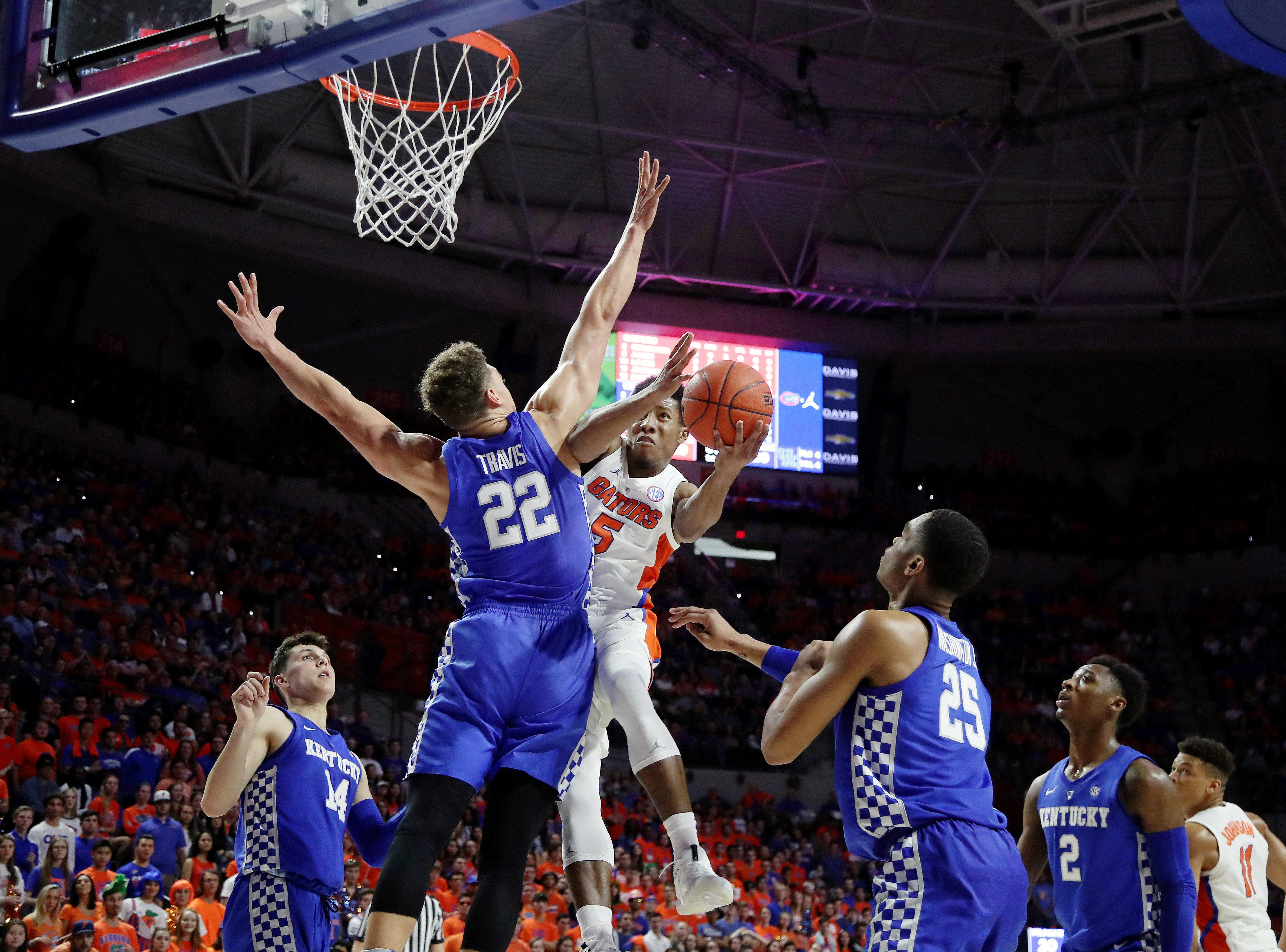 Kentucky Wildcats forward Reid Travis (22) defends Florida Gators guard KeVaughn Allen (5) layup during the first half at Exactech Arena in Gainesville, Florida, on Saturday, Feb. 2, 2019.