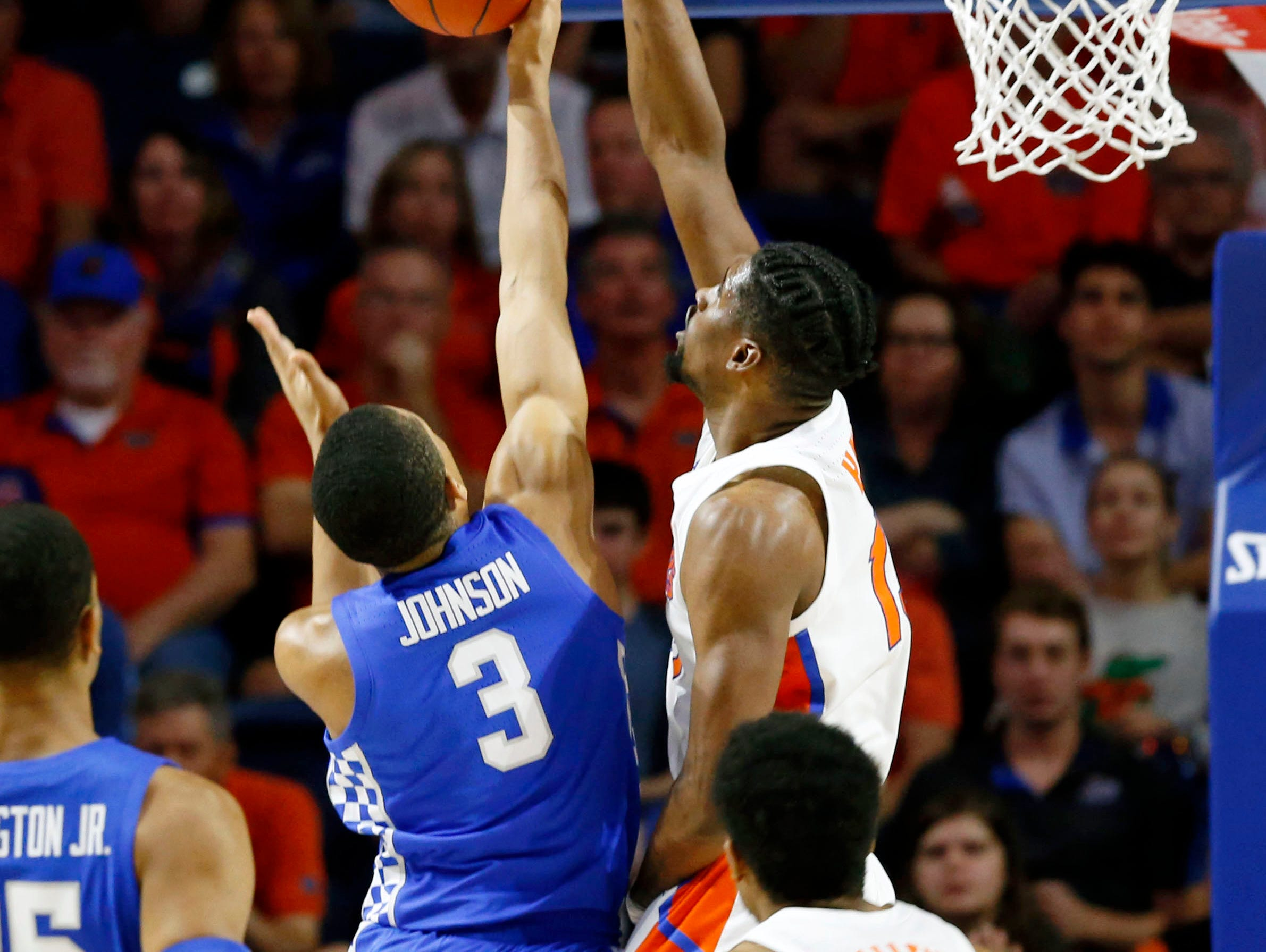 Florida Gators center Kevarrius Hayes (13) blocks Kentucky Wildcats guard Keldon Johnson (3) shot  during the first half at Exactech Arena in Gainesville, Florida, on Saturday, Feb. 2, 2019.