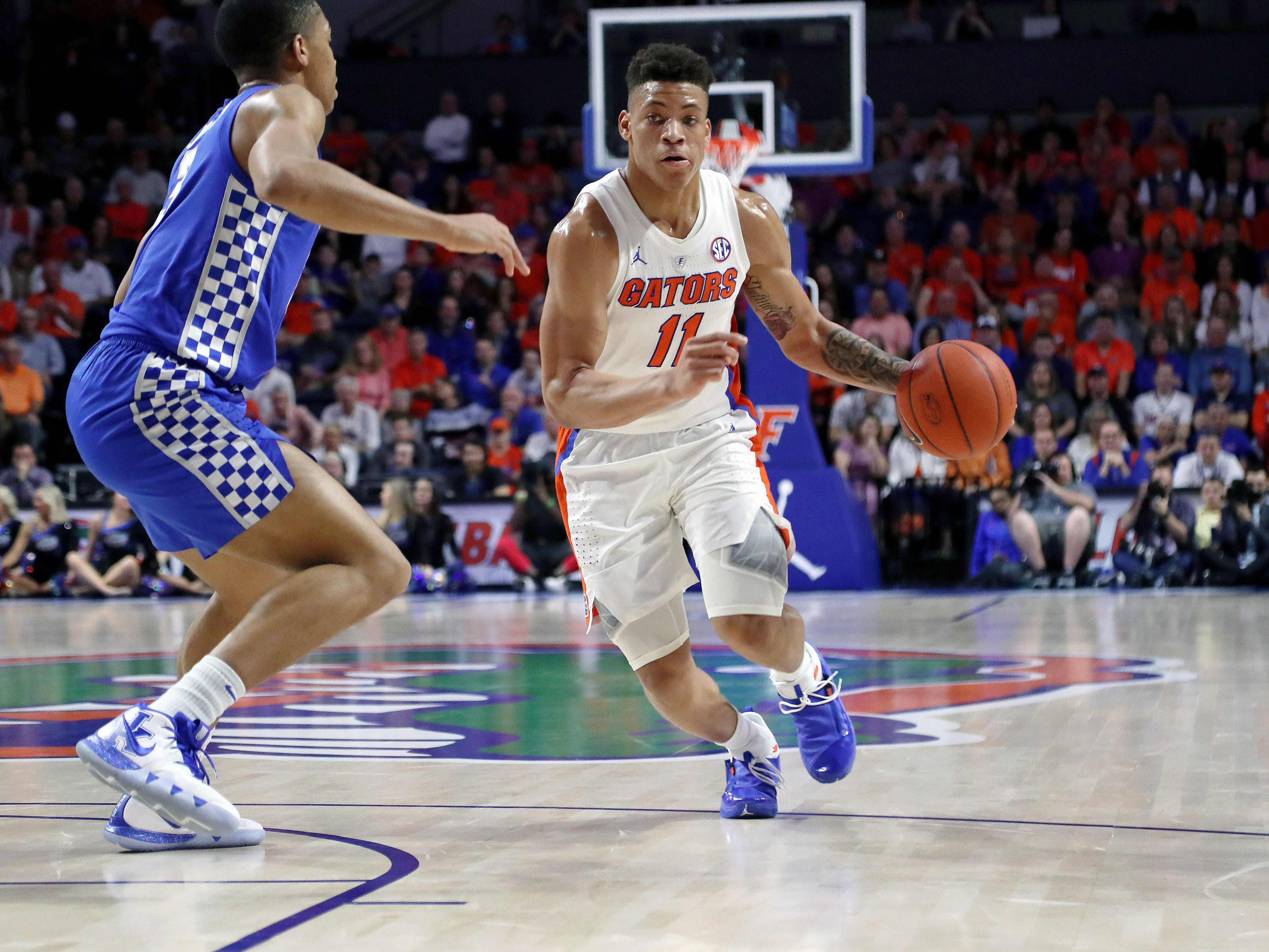 Florida Gators forward Keyontae Johnson (11) drives to the basket as Kentucky Wildcats guard Keldon Johnson (3) defends during the first half at Exactech Arena in Gainesville, Florida, on Saturday, Feb. 2, 2019.