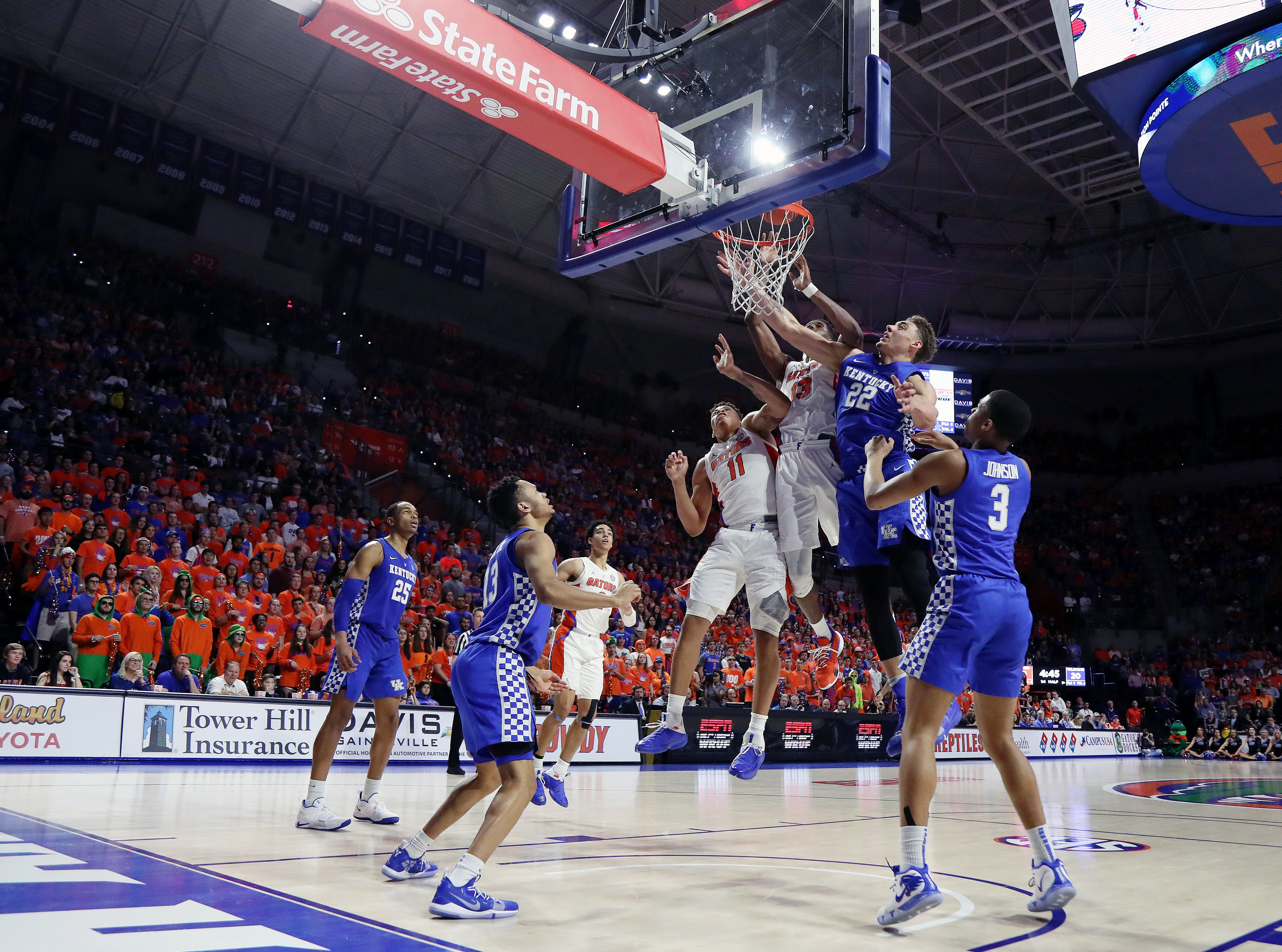 Florida Gators forward Keyontae Johnson (11) makes a layup over Kentucky Wildcats forward Reid Travis (22) during the first half at Exactech Arena in Gainesville, Florida, on Saturday, Feb. 2, 2019.
