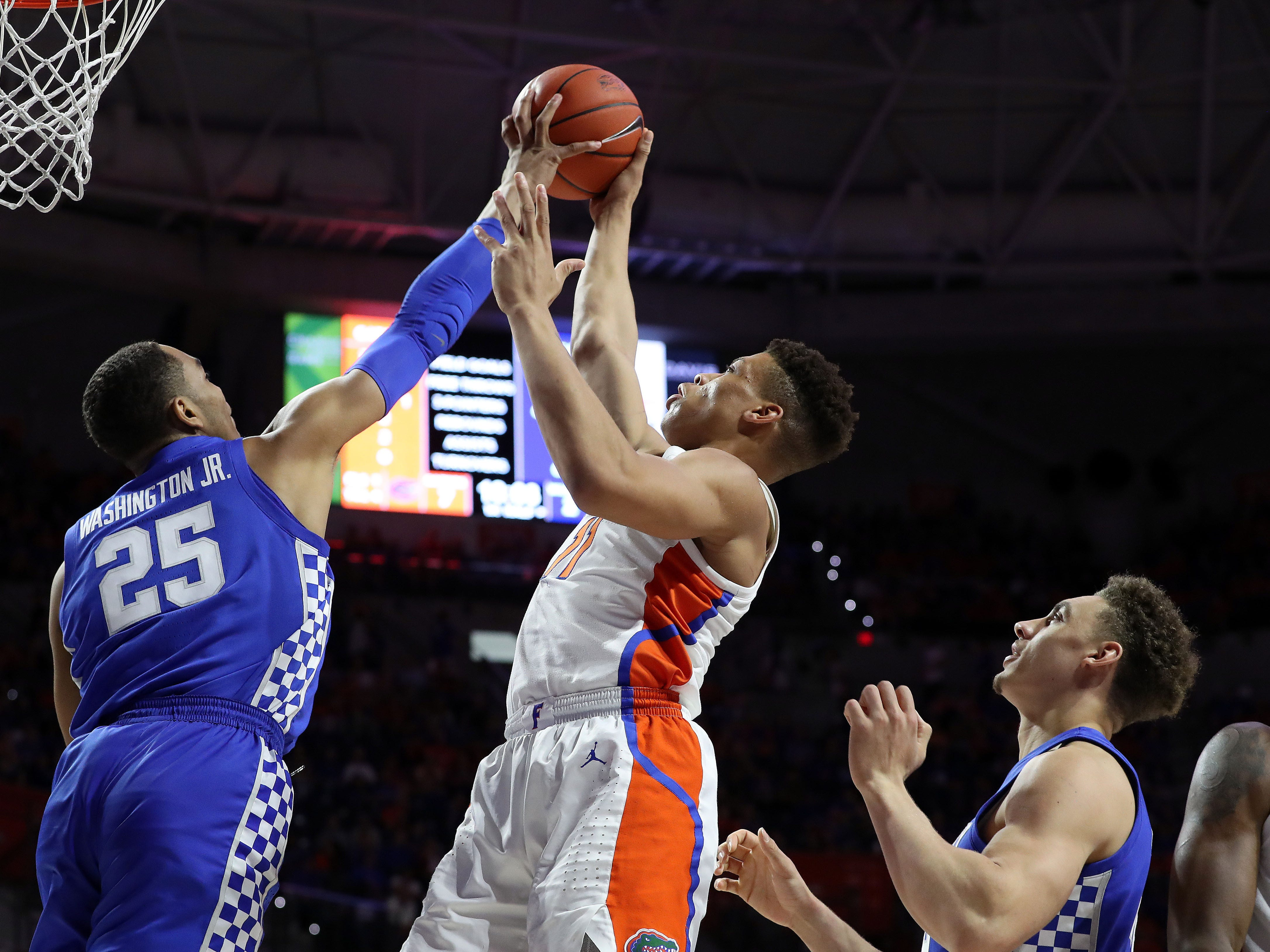 Kentucky Wildcats forward PJ Washington (25) blocks Florida Gators forward Keyontae Johnson (11) shot during the first half at Exactech Arena in Gainesville, Florida, on Saturday, Feb. 2, 2019.