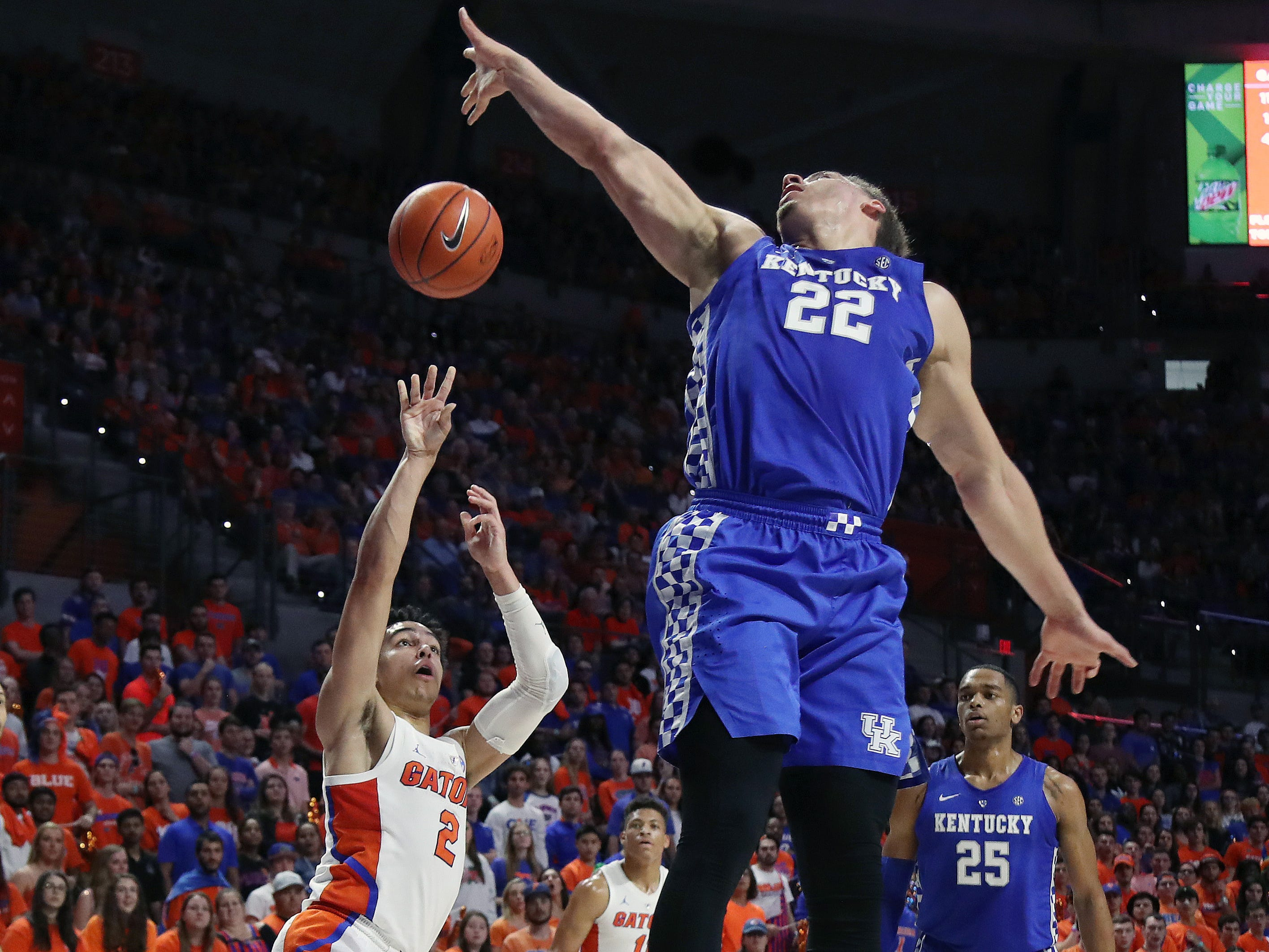 Florida Gators guard Andrew Nembhard (2) shoots over Kentucky Wildcats forward Reid Travis (22)  during the first half at Exactech Arena in Gainesville, Florida, on Saturday, Feb. 2, 2019.