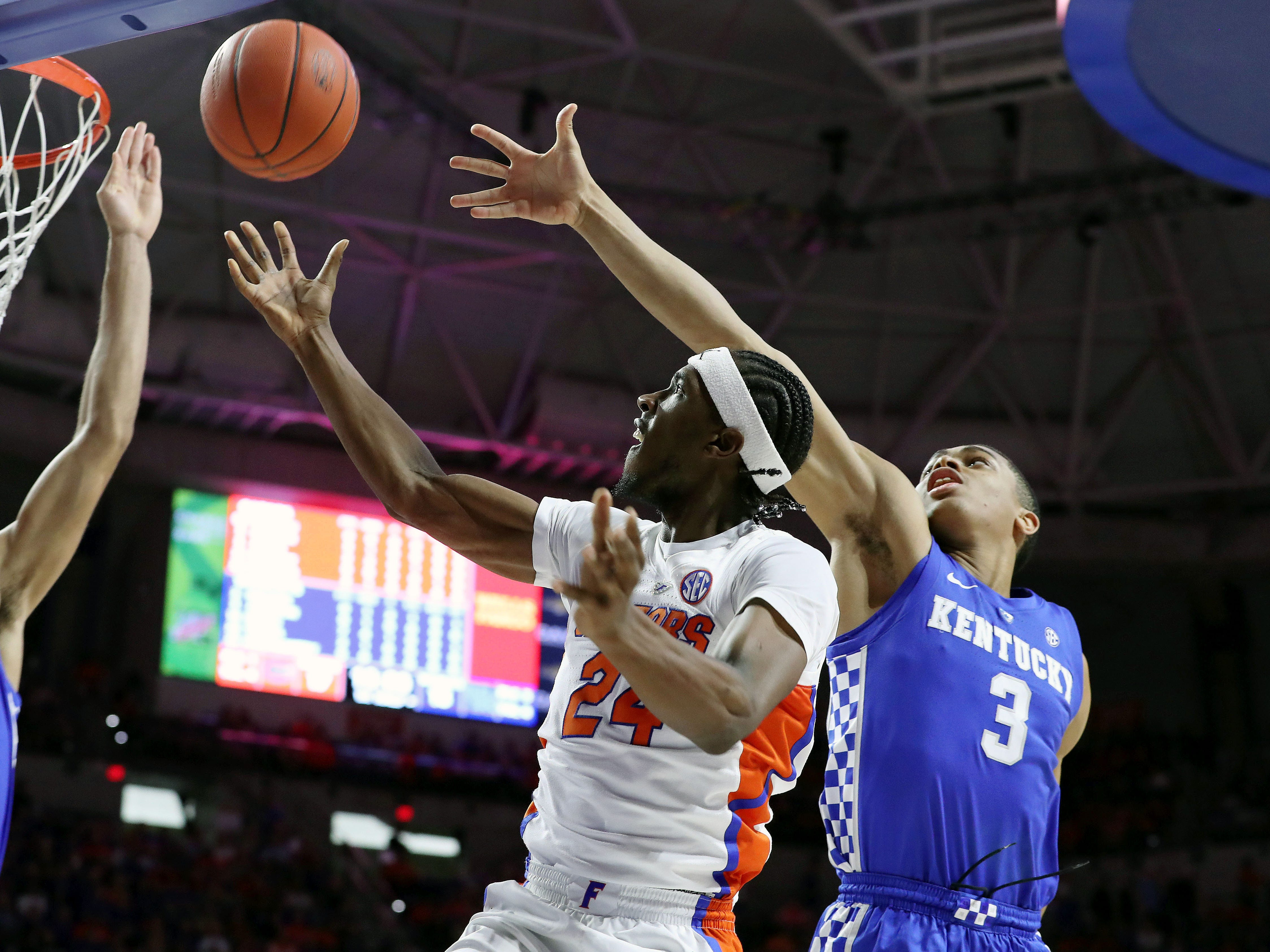 Kentucky Wildcats forward EJ Montgomery (23) blocks Florida Gators guard Deaundrae Ballard (24) shot during the first half at Exactech Arena in Gainesville, Florida, on Saturday, Feb. 2, 2019.