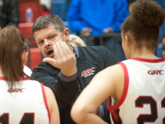 George Rogers Clark's acting head basketball coach Steve Anderson plots with his team during a timeout.