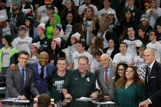 Tom Izzo and his family pose for a photo with the ESPN hosts, including Jay Bilas (far right) at the Breslin Center Saturday, Feb. 2, 2019.