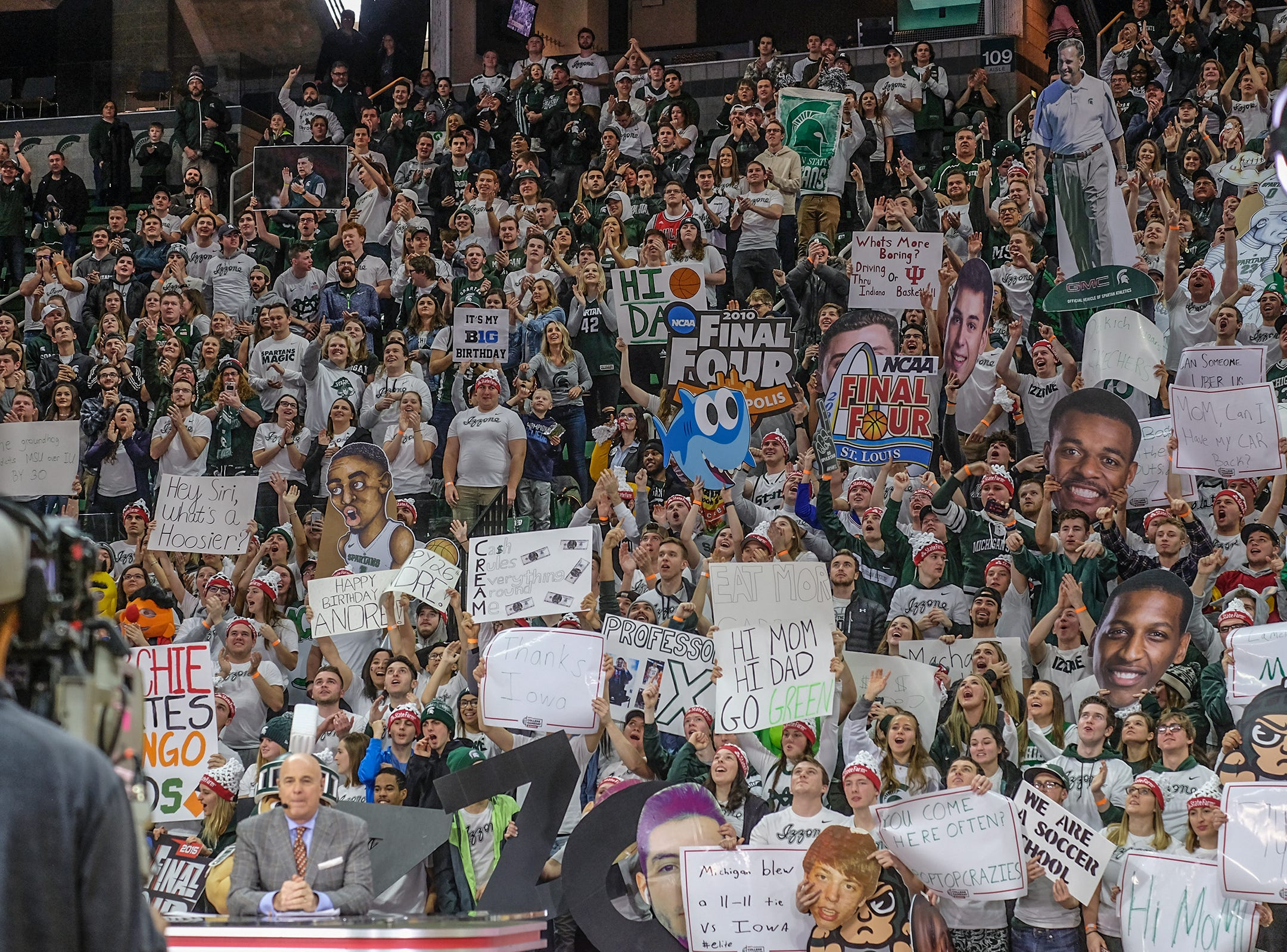 Fans with plenty of signs cheer during the ESPN College GameDay broadcast at the Breslin Center Saturday, Feb. 2, 2019.