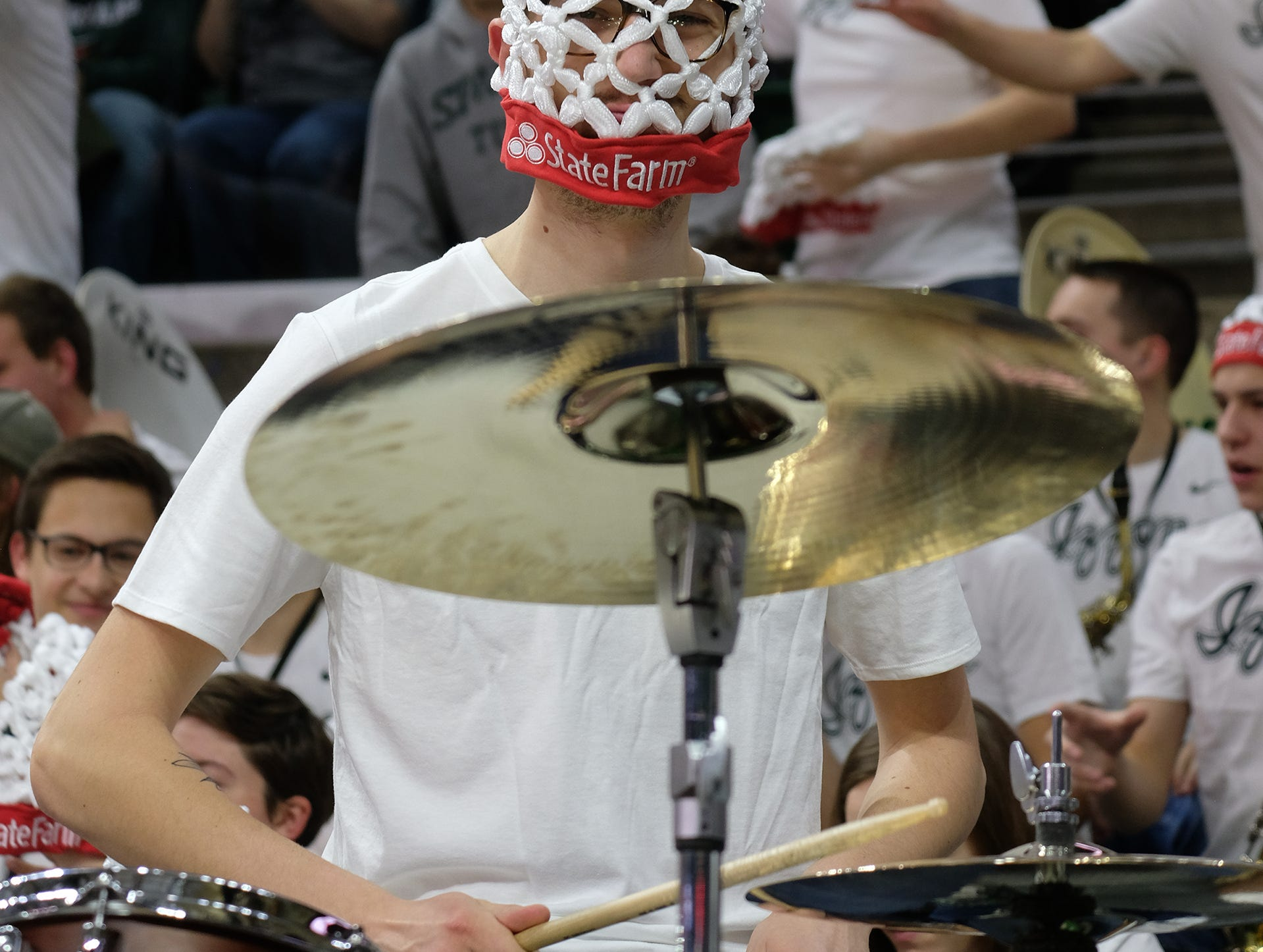 A drummer with some State Farm swag plays at the ESPN College GameDay at MSU Saturday, Feb. 2, 2019.