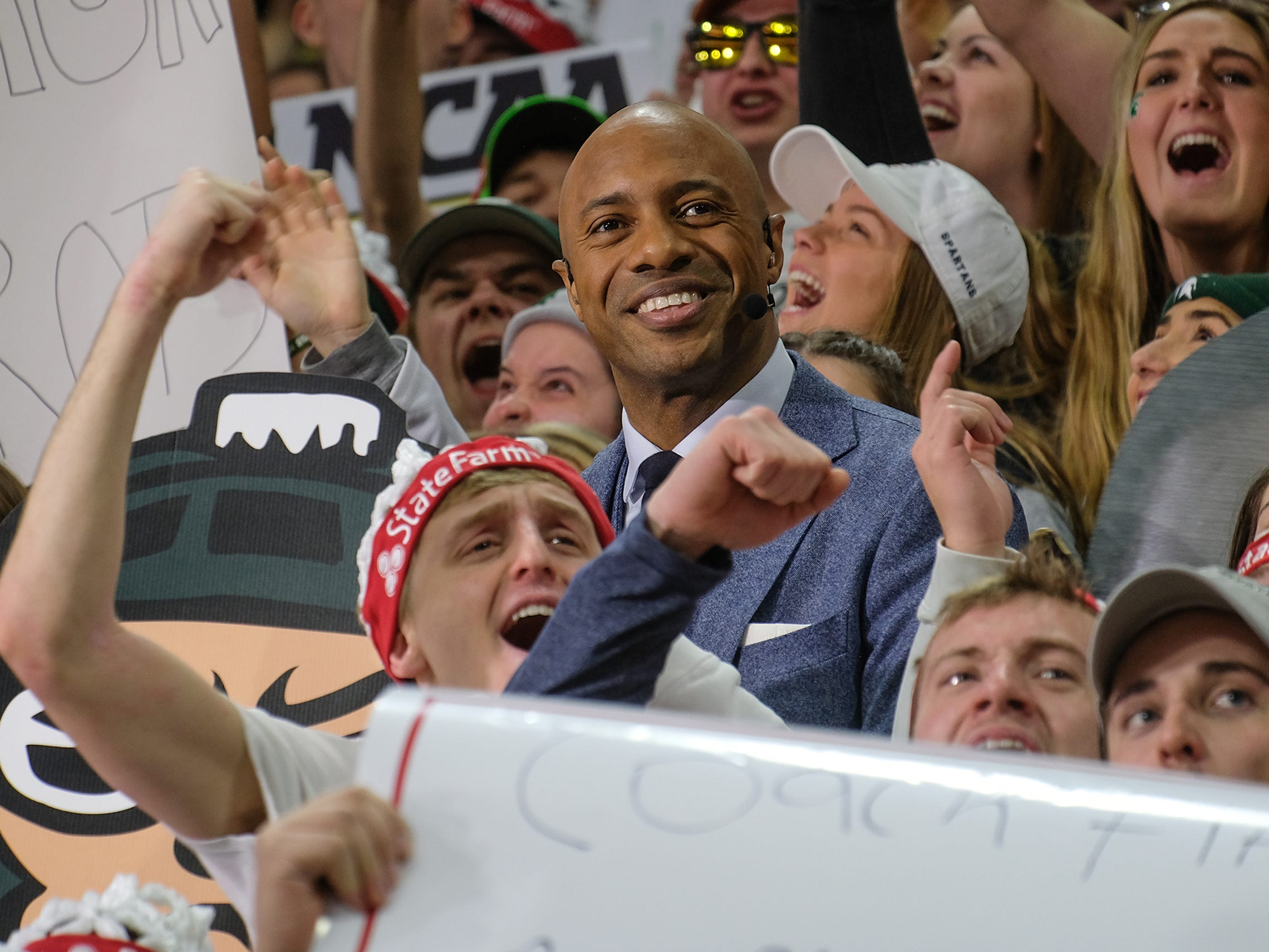 ESPN College GameDay host Jay Williams gets up into the crowd at the Breslin Center Saturday, Feb. 2, 2019.