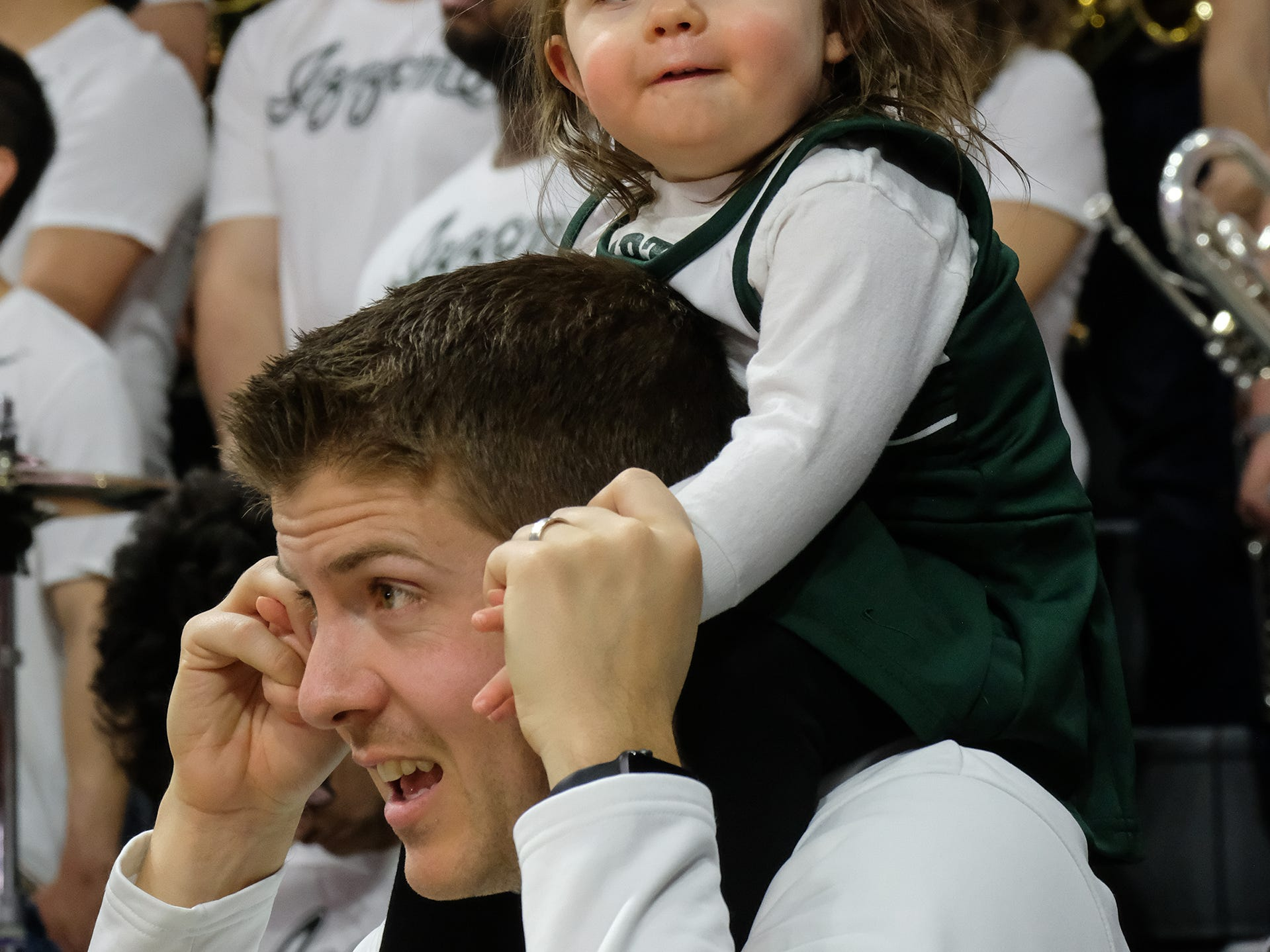 MSU Band Director with his 22-month-old daughter Taylor, have fun at the ESPN College GameDay broadcast at the Breslin Center Saturday, Feb. 2, 2019.