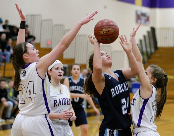 Two Rivers' Kiley Graff (24) blocks a shot by Roncalli's Kaitlyn Freis (24) at Two Rivers High School Friday, February 1, 2019, in Two Rivers, Wis. Joshua Clark/USA TODAY NETWORK-Wisconsin