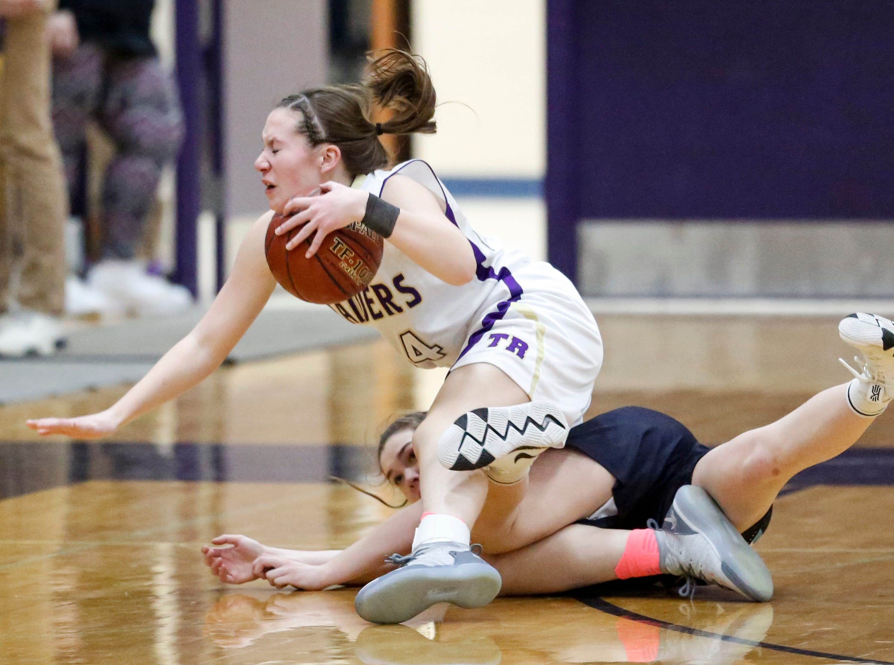 Two Rivers' Kiley Graff (24) gets tripped up by Roncalli's Maya Lusk (3) at Two Rivers High School Friday, February 1, 2019, in Two Rivers, Wis. Joshua Clark/USA TODAY NETWORK-Wisconsin