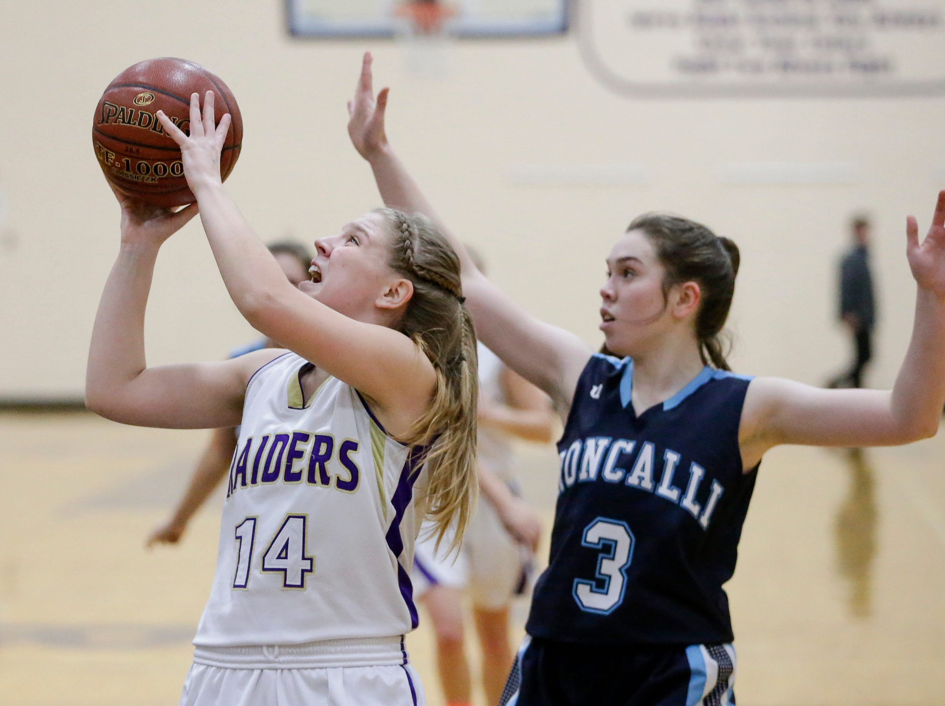 Two Rivers' Andrea Henrickson (14) shoots against Roncalli at Two Rivers High School Friday, February 1, 2019, in Two Rivers, Wis. Joshua Clark/USA TODAY NETWORK-Wisconsin