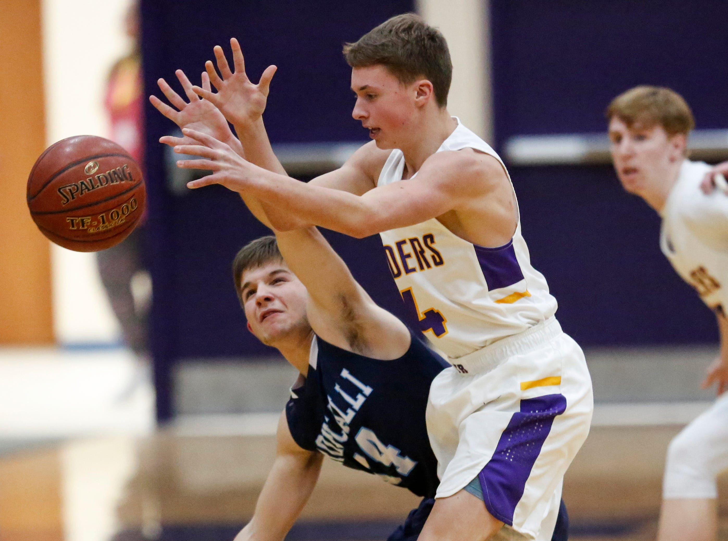 Roncalli's Ethan Jagemann (14) knocks the ball away from Two Rivers' Braden Schroeder (4) at Two Rivers High School Friday, February 1, 2019, in Two Rivers, Wis. Joshua Clark/USA TODAY NETWORK-Wisconsin