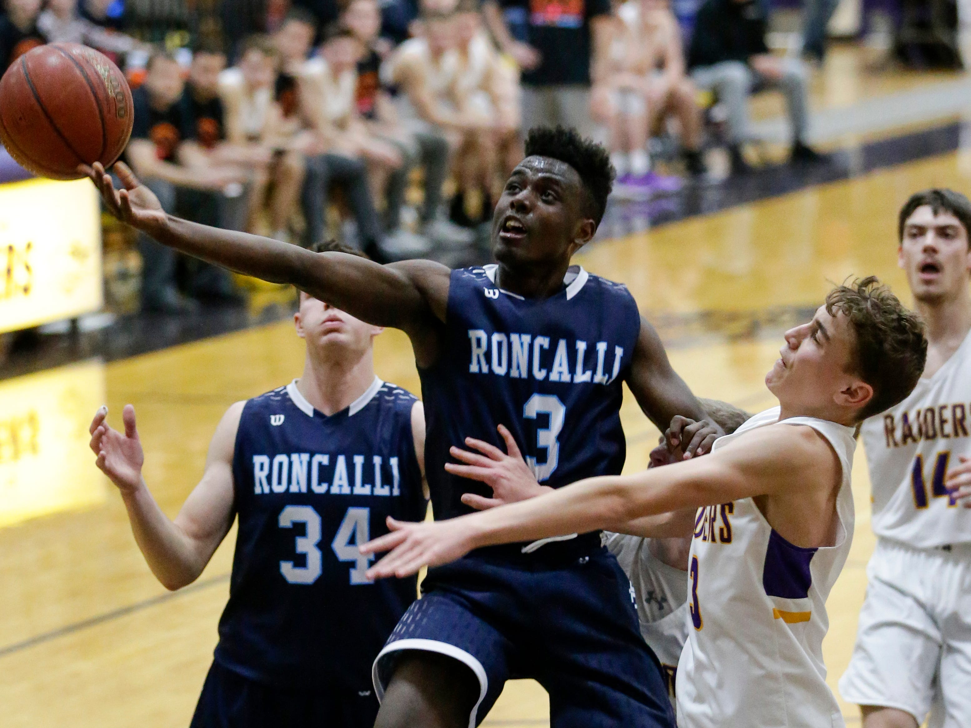 Roncalli's Chombi Lambert (3) shoots against Two Rivers at Two Rivers High School Friday, February 1, 2019, in Two Rivers, Wis. Joshua Clark/USA TODAY NETWORK-Wisconsin
