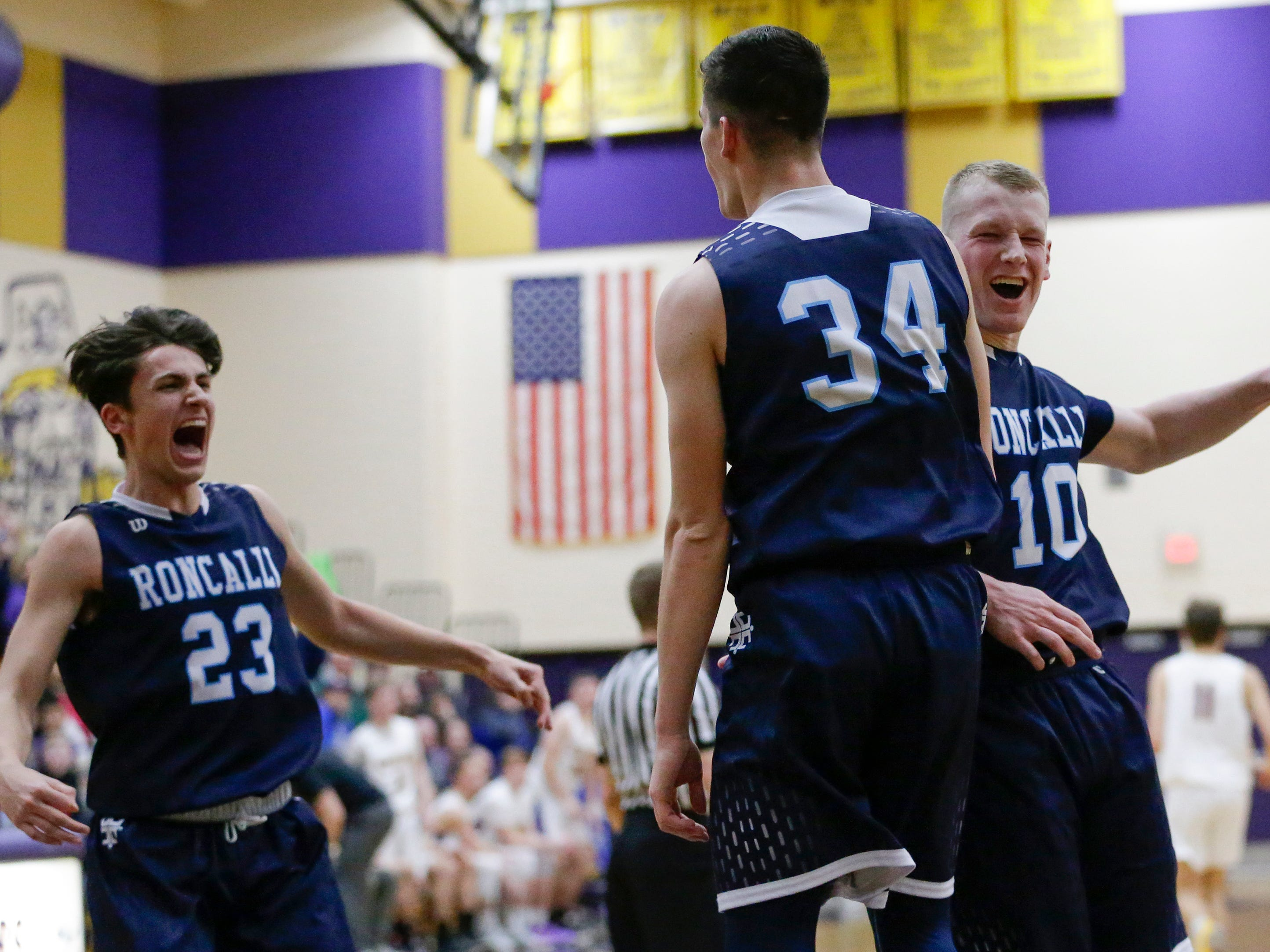 Roncalli's Ian Behringer (34) reacts after sinking a buzzer beater from half court against Two Rivers at Two Rivers High School Friday, February 1, 2019, in Two Rivers, Wis.
