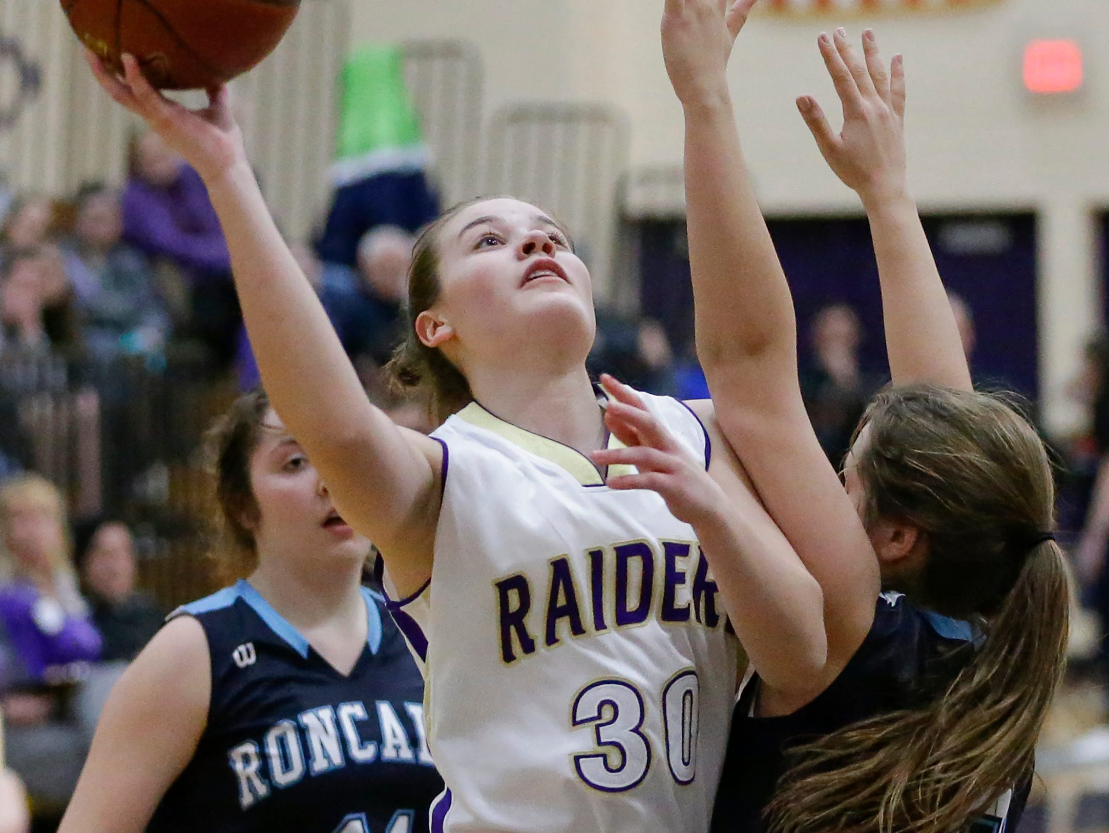 Two Rivers' Mackenzie Graff (30) shoots against Roncalli at Two Rivers High School Friday, February 1, 2019, in Two Rivers, Wis. Joshua Clark/USA TODAY NETWORK-Wisconsin