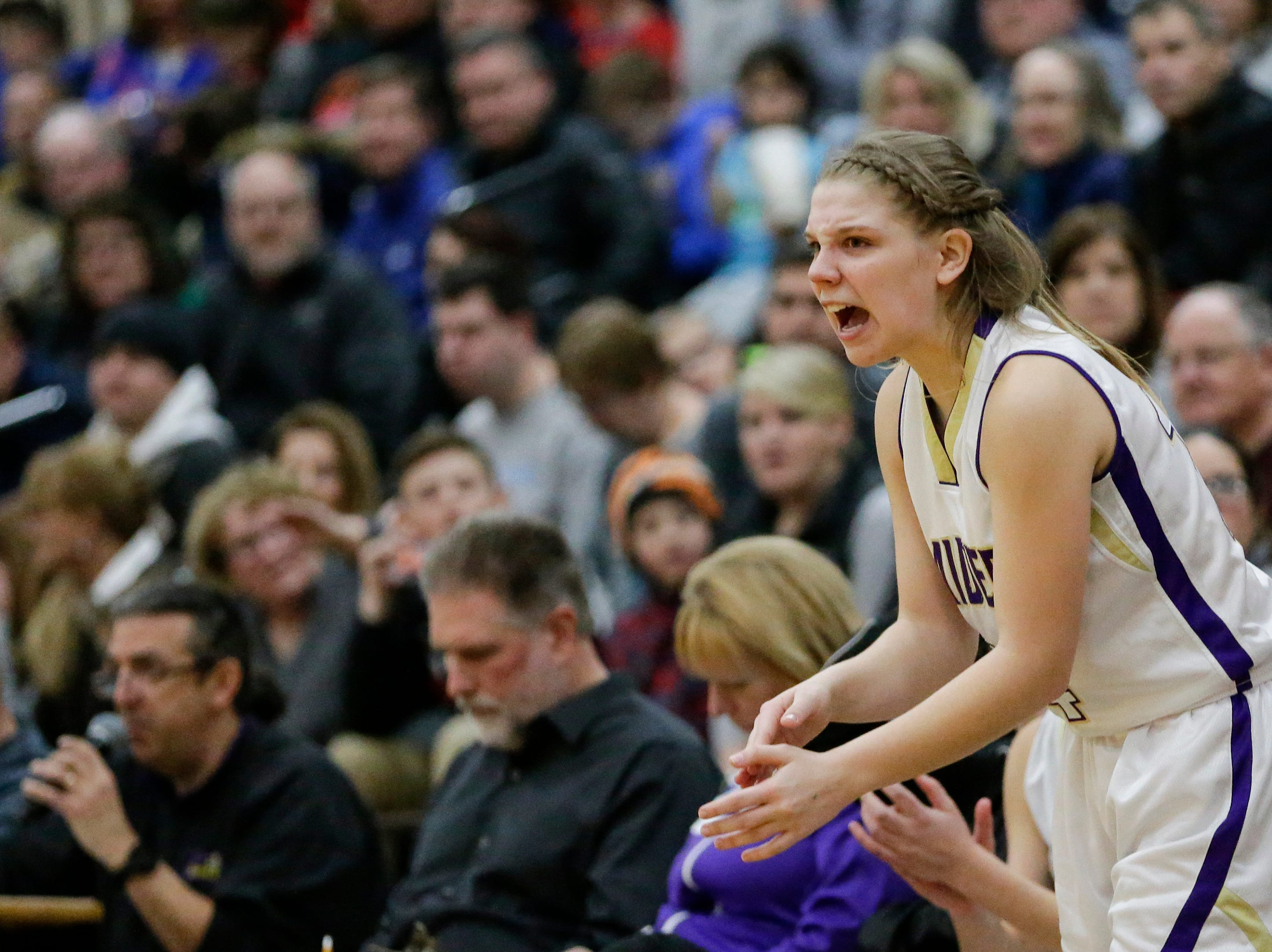 Two Rivers' Andrea Henrickson (14) cheers on her teammates from the bench against Roncalli at Two Rivers High School Friday, February 1, 2019, in Two Rivers, Wis. Joshua Clark/USA TODAY NETWORK-Wisconsin