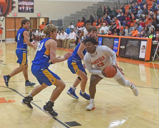 Quan Hilory of Mansfield Senior tries to find an open route to the basket Friday night during a game with Wooster.