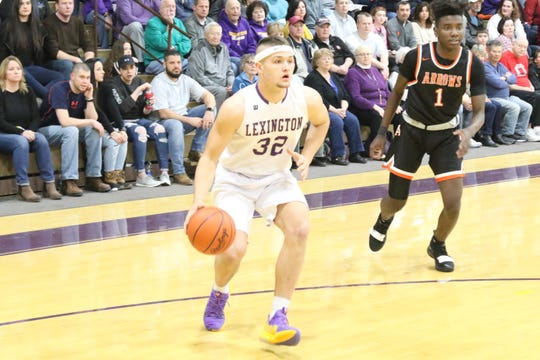 Lexington's Cade Stover led the Minutemen to victory with 34 points and 11 rebounds on Friday night against Ashland.