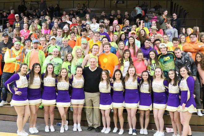 Jerry Snodgrass, front center, then the Ohio High School Athletic Association executive director, stopped by Lexington High School to pay a visit to the Purple Haze, the Lexington student section, in February, 2019.