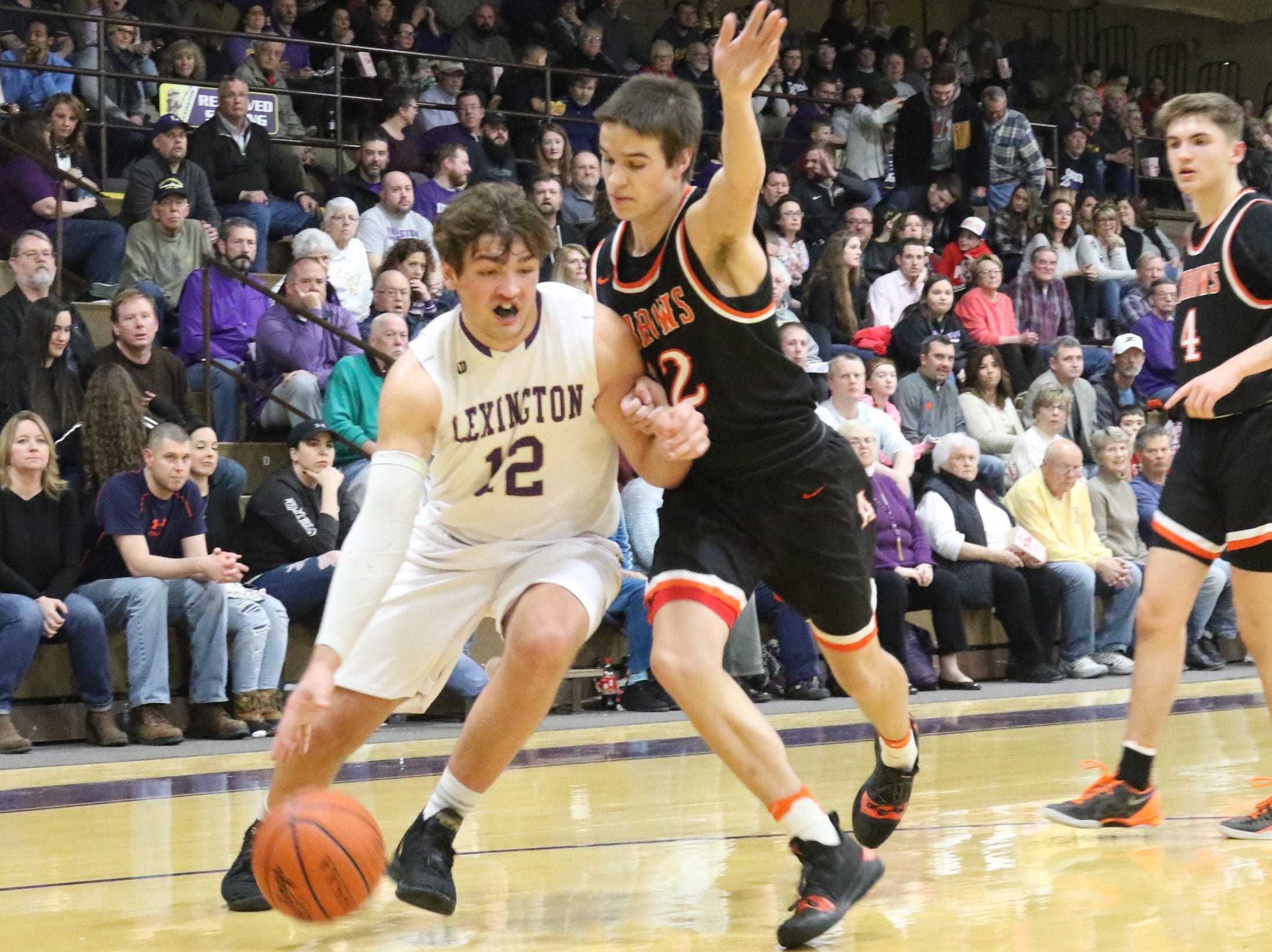 Lexington's Ben Vore drives to the hoop in the Minutemen's victory over Ashland on Friday night.
