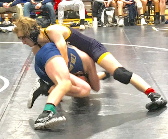 Lexington freshman Noah Baker prepares to turn Tiffin Columbian's Garrett Chester en route to a pin in Saturday's OHSAA team tournament at Lex.