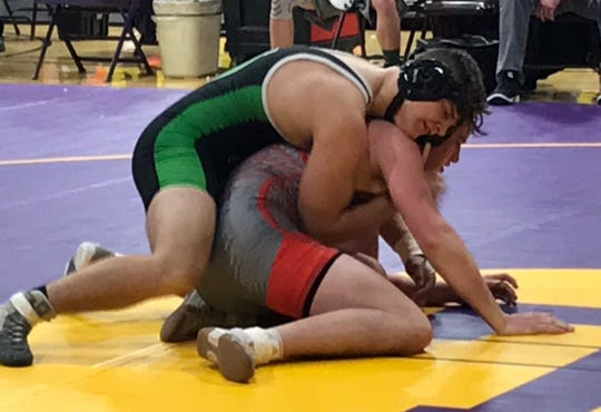 Clear Fork junior Blake Miller battles with Bellevue's Braxton Berry in Saturday's OHSAA team tournament action at Lexington High School.