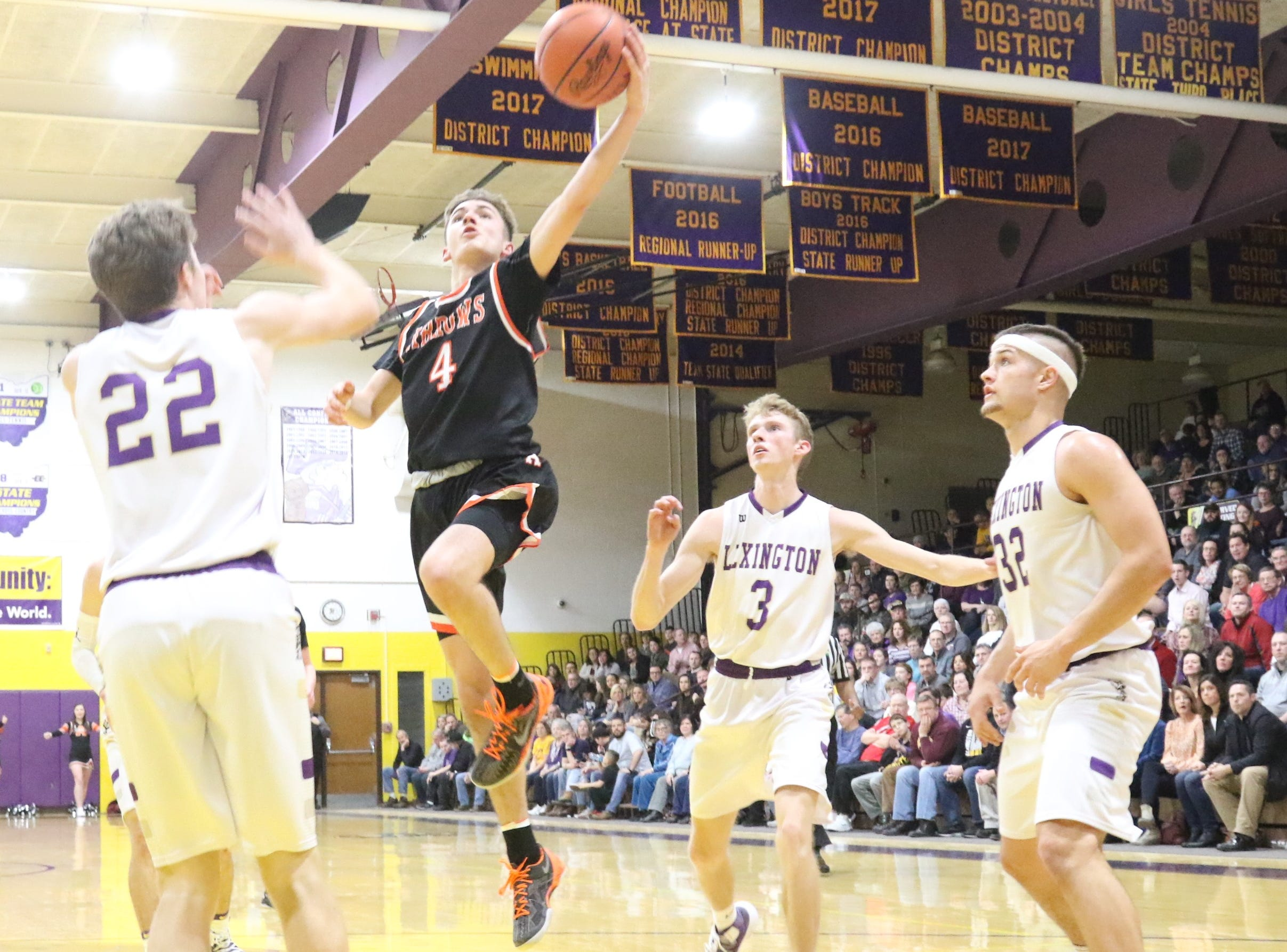 Ashland's Luke Denbow scores on a left-handed layup during the Arrows' loss to Lexington on Friday night.