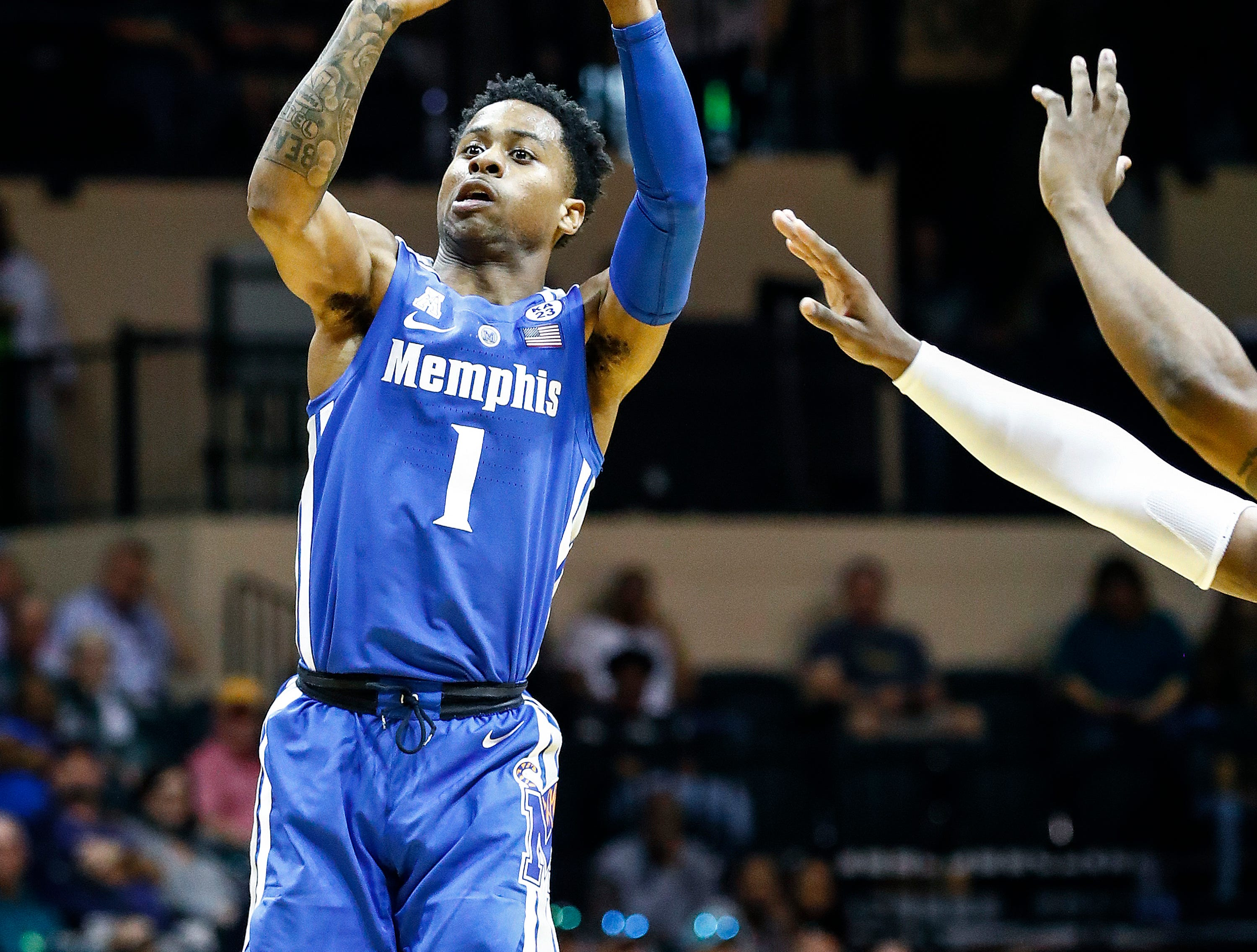 Memphis guard Tyler Harris puts up a 3-pointer against the USF defense during action in Tampa, Saturday, February 2, 2019.