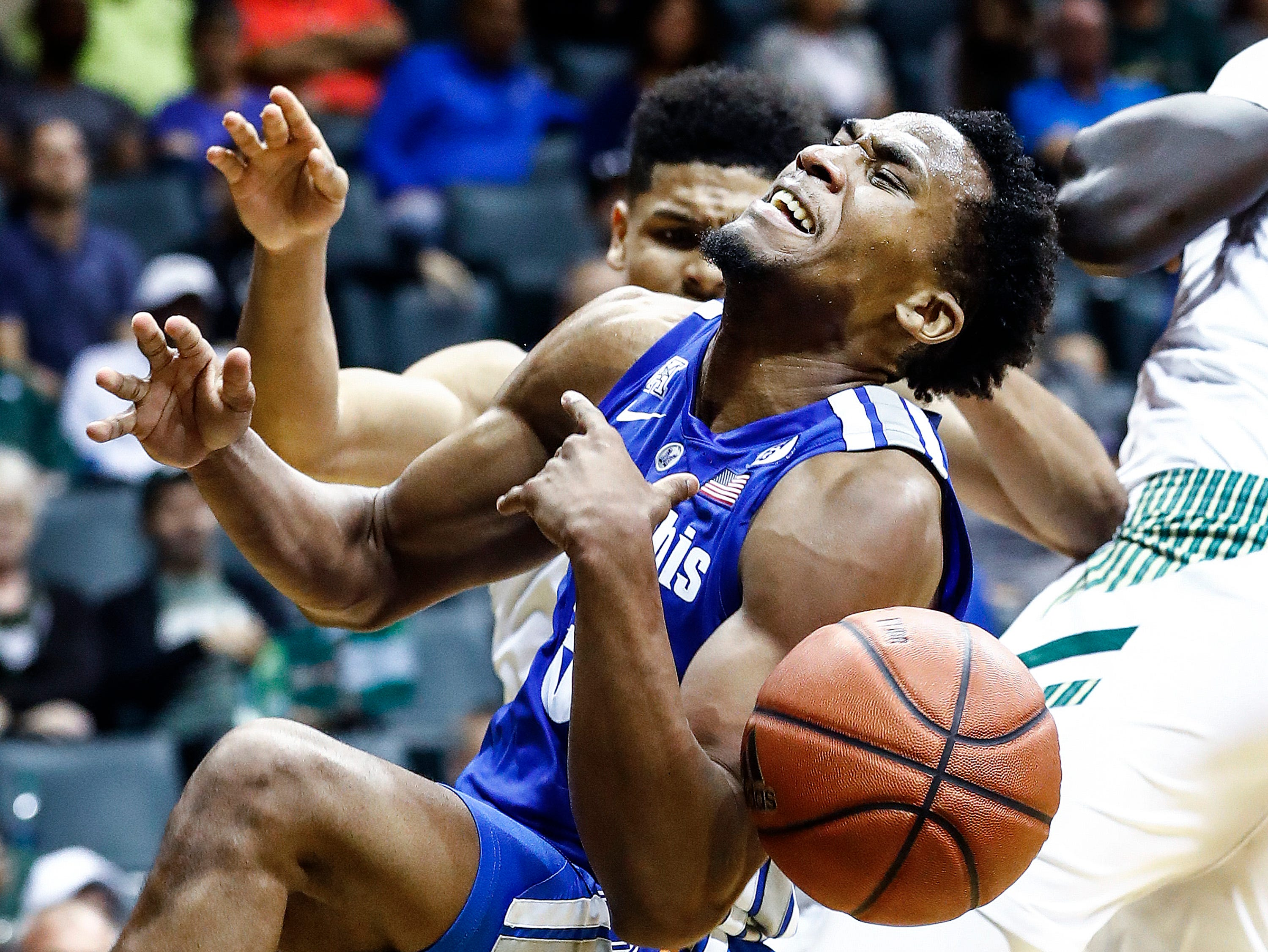Memphis guard Jeremiah Martin is fouled by USF while grabbing a rebound during action in Tampa, Saturday, February 2, 2019.