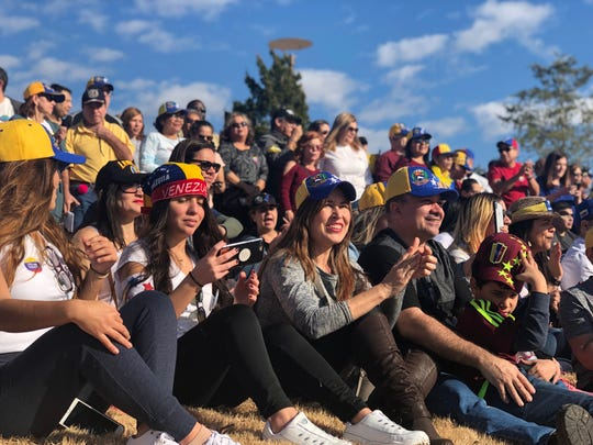 On an international day of action, Memphis Venezuelans rally at Shelby Farms Park in support of opposition leader Juan Guaido.