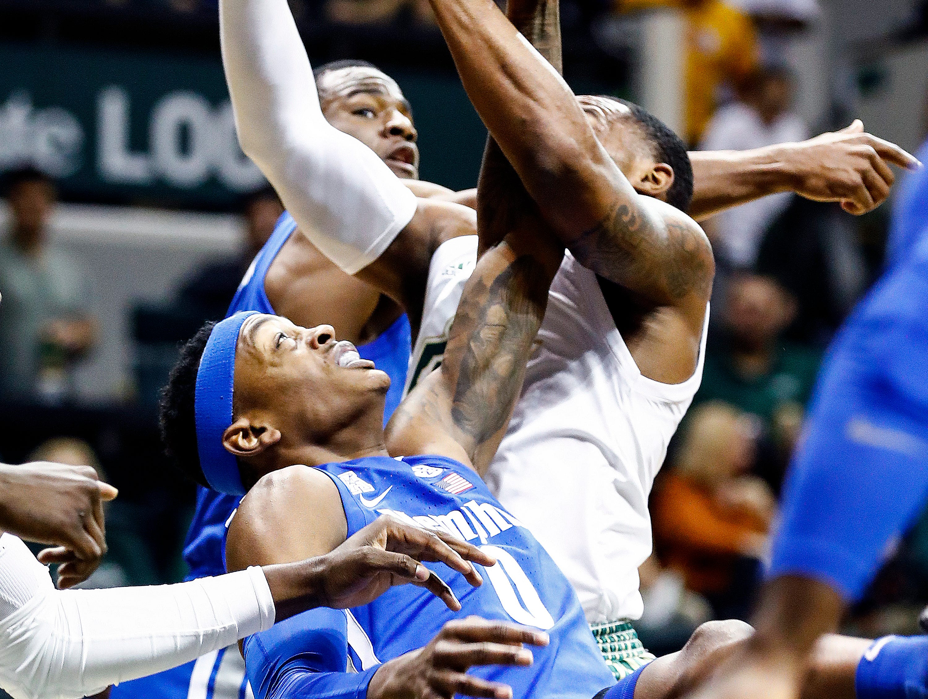 Memphis forward Kyvon Davenport (bottom) can not grab a rebound against USF during action in Tampa, Saturday, February 2, 2019.