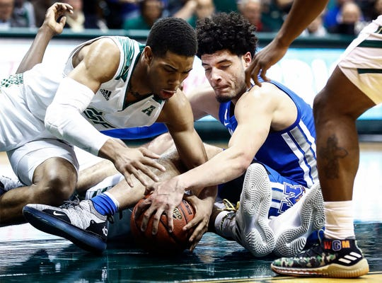After losing control of the ball, Memphis forward Isaiah Maurice (right) battles USF defender David Collins (left) to gain possession during action in Tampa, Saturday, February 2, 2019.