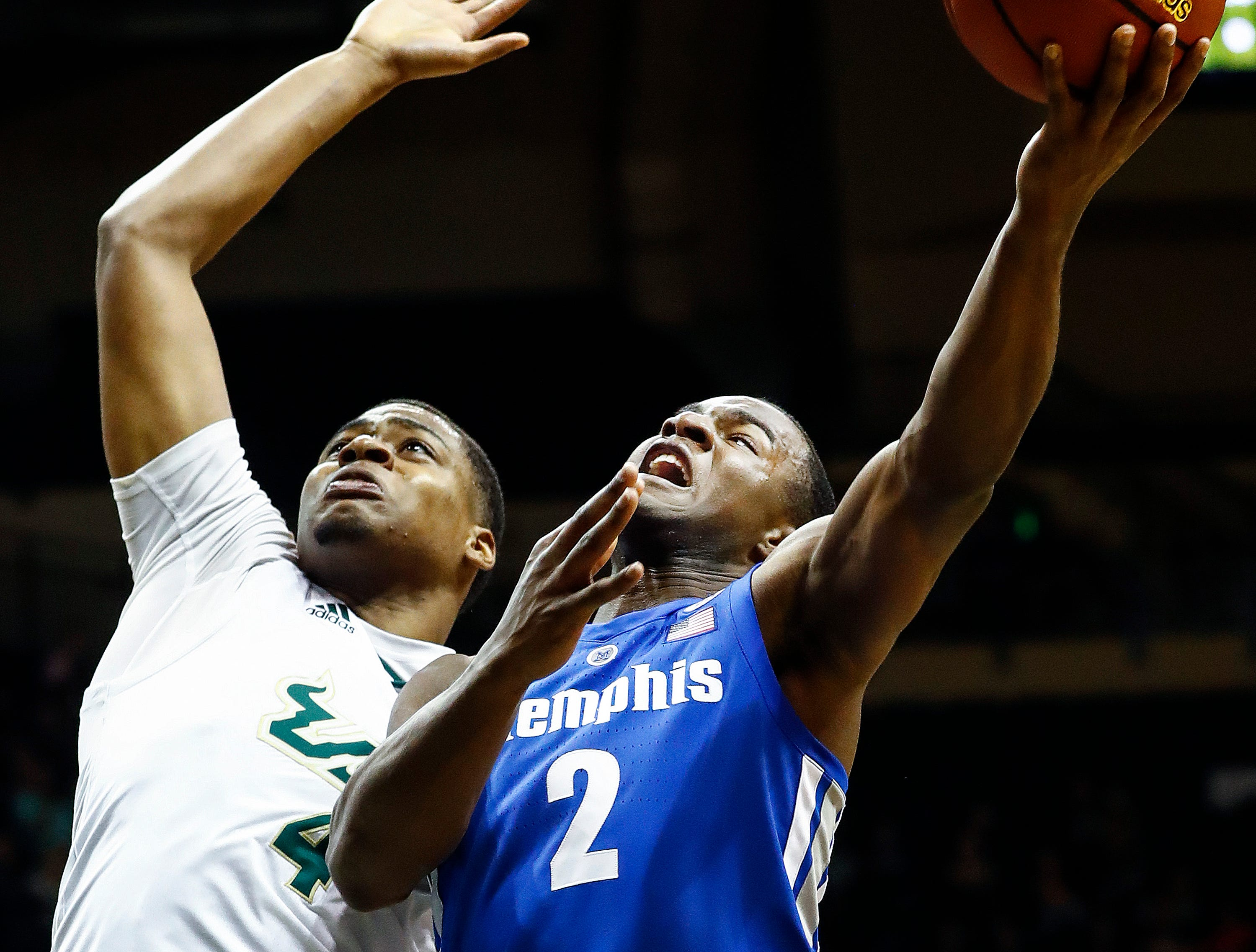Memphis guard Alex Lomax (right) drives to the basket against USF defender Michael Durr (left) during action in Tampa, Saturday, February 2, 2019.